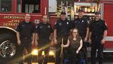 Jacksonville firefighters assist student in wheelchair performing at graduation ceremony