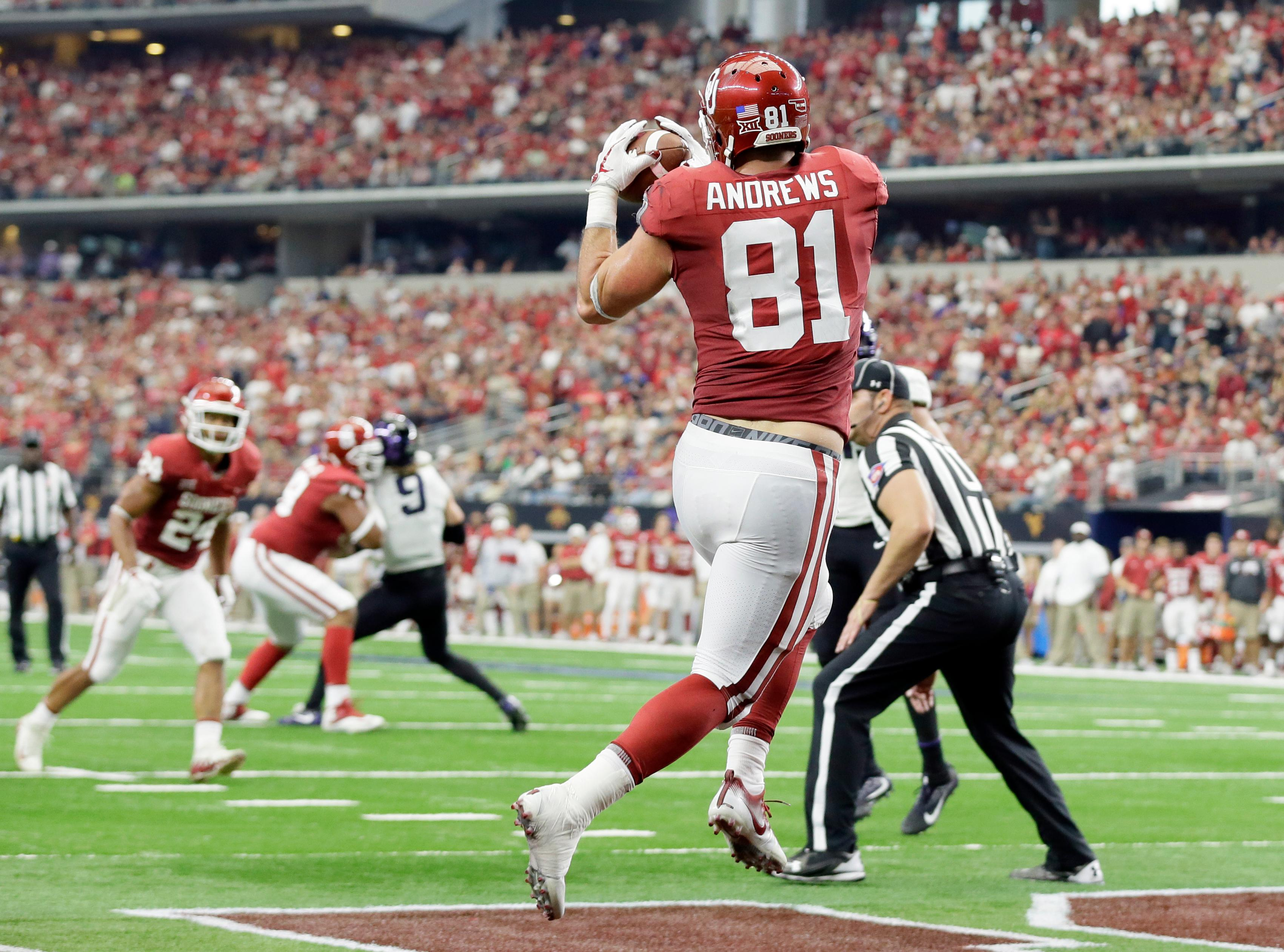 Oklahoma tight end Mark Andrews (81) catches a pass in the end zone for a touchdown in the first half of the Big 12 Conference championship NCAA college football game against TCU on Saturday, Dec. 2, 2017, in Arlington, Texas. (AP Photo/Tony Gutierrez)