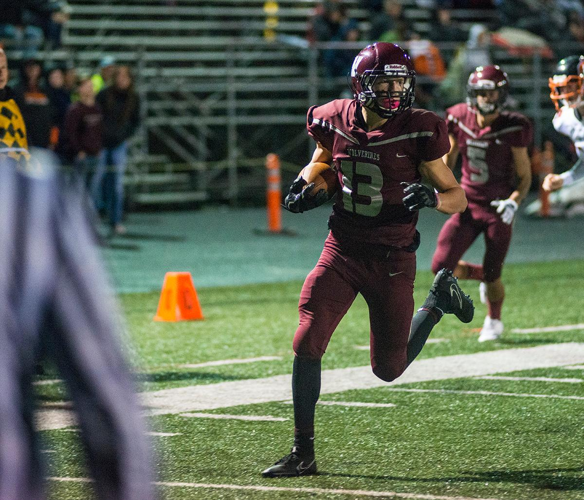 Willamette Wolverines Bryce Goggin (#13) makes it to the end zone for a touchdown. Roseburg Indians defeated Willamette Wolverines 21-20 at Wolverine Stadium on Friday night in Eugene. Photo by Rhianna Gelhart, Oregon News Lab