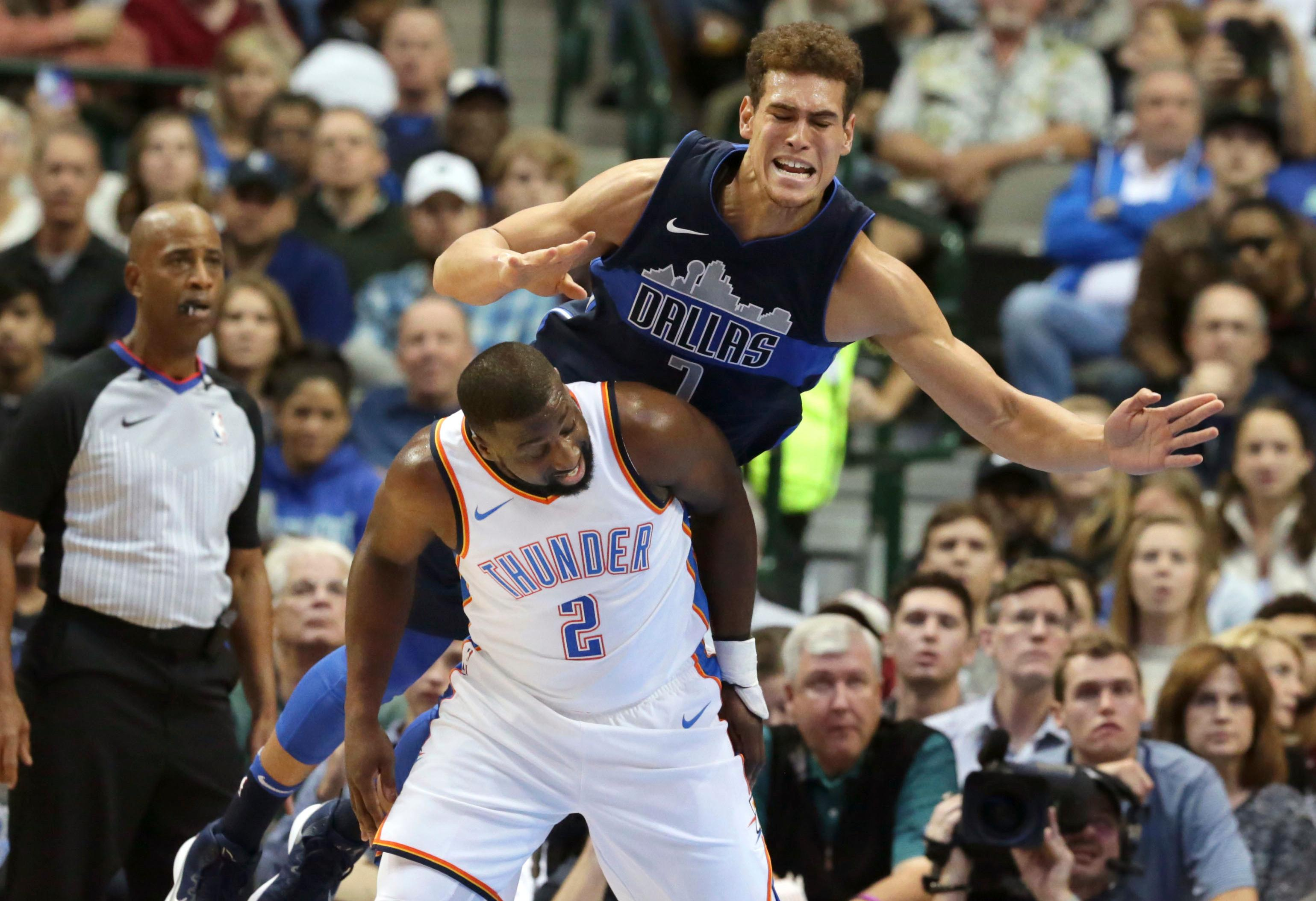 Oklahoma City Thunder guard Raymond Felton (2) blocks out Dallas Mavericks forward Dwight Powell (7) during the first half of an NBA basketball game in Dallas, Saturday, Nov. 25, 2017. (AP Photo/LM Otero)