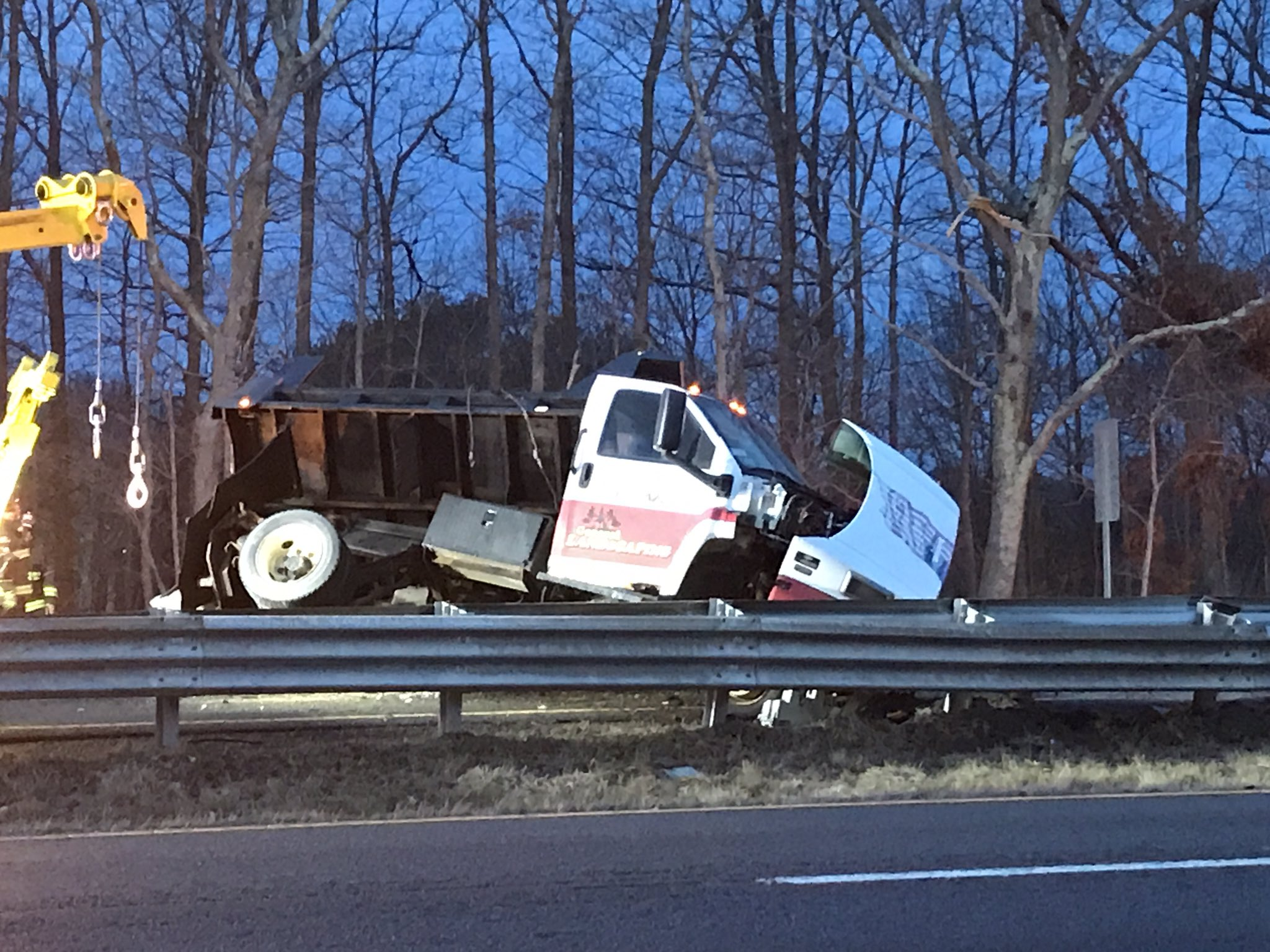 A dump truck and at least two cars were involved in a crash on Route 24 in Fall River, Thursday, Feb. 8, 2018. (WJAR)
