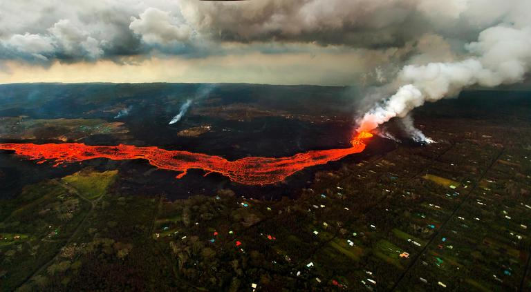 FILE - Lava from the Kilauea volcano flows in and around Pahoa, Hawaii, Sunday, June 10, 2018. (AP Photo/L.E. Baskow)
