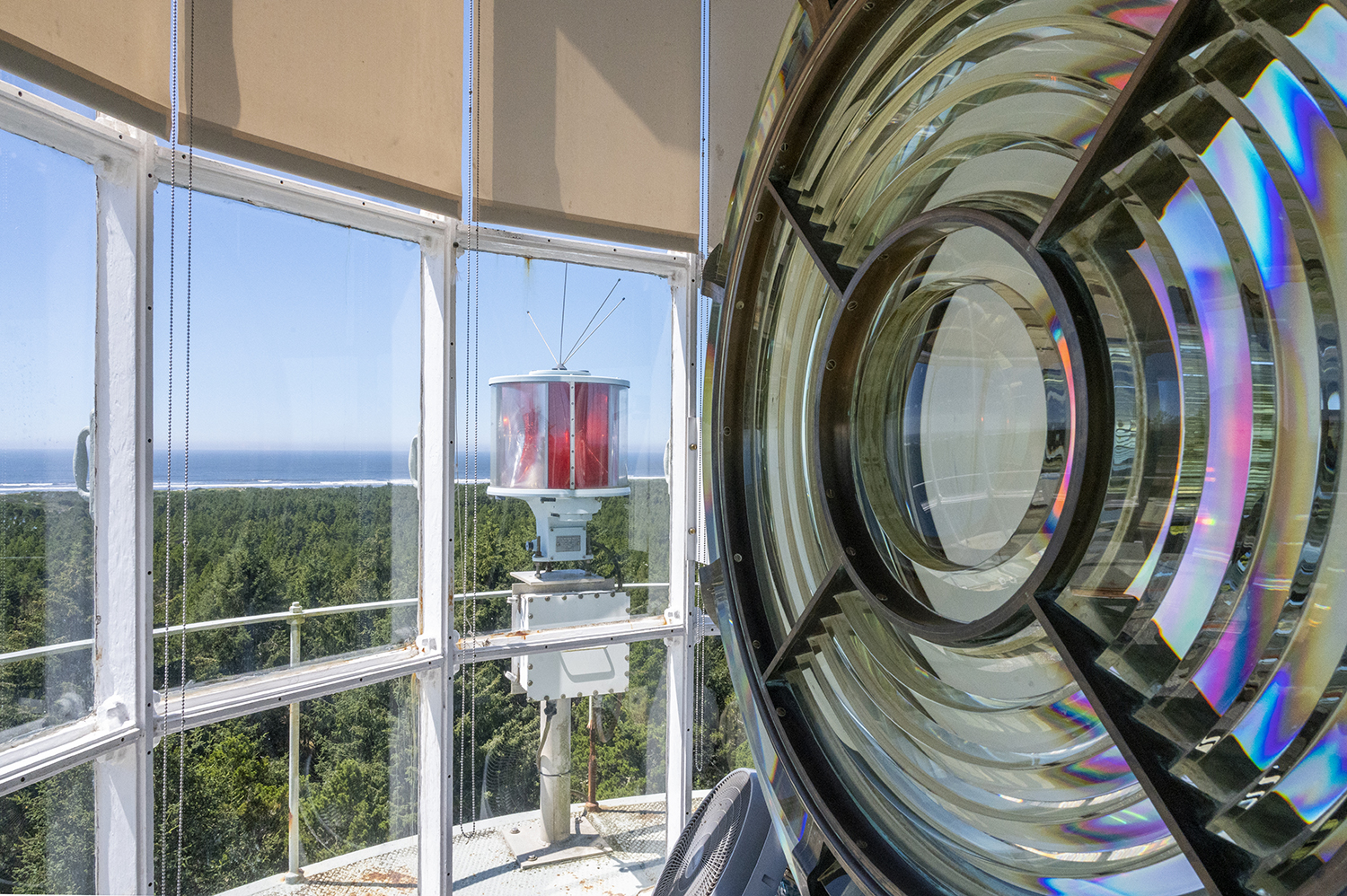 Enjoy a 360-degree view of the Pacific Ocean while standing beside the original 1895 Fresnel lens built in Paris, France. While the original lens was deactivated from use in 1992, a new rotational light was installed on the balcony that shines a beam for 19 miles. (Image: Rachael Jones / Seattle Refined)