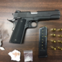 Man caught with stolen weapon, drugs