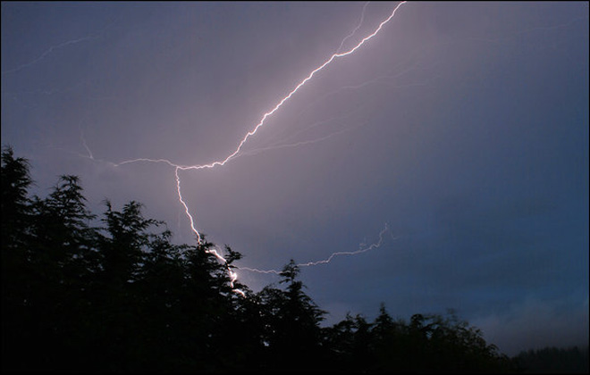 A bolt of lightning is seen in a Friday morning thunderstorm in Sequim. (Photo by YouNews contributor patnmikes)