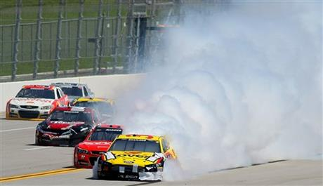 David Ragan (34) moves out of the lane as his car is engulfed in smoke during the NASCAR Aaron's 499 Sprint Cup series auto race at Talladega Superspeedway, Sunday, May 4, 2014, in Talladega, Ala. (AP Photo/Greg McWilliams)