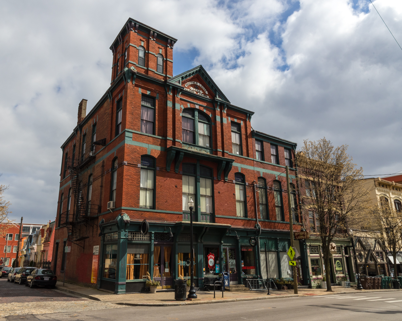 SPUN Bicycles is located in the middle of the historic Hoffner Lodge (built 1885) on Hamilton Avenue in Northside. The building's architect was none other than the legendary Samuel Hannaford. / Image: Phil Armstrong, Cincinnati Refined // Published: 3.19.17