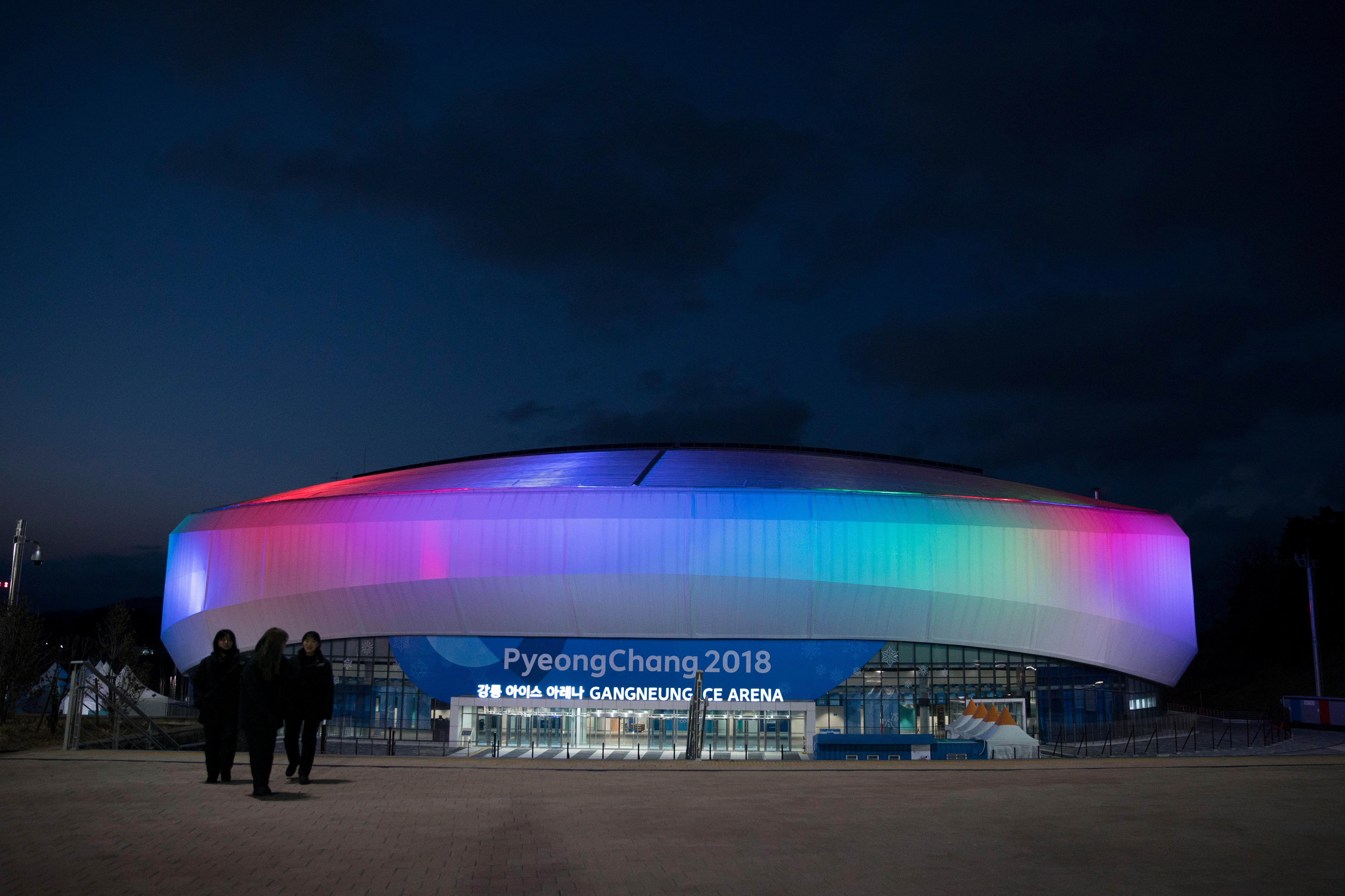 The Gangneung Ice Arena is illuminated at night during a Men's Short Track Speed Skating training session ahead of the 2018 Winter Olympics in Gangneung, South Korea, Friday, Feb. 2, 2018. (AP Photo/Felipe Dana)
