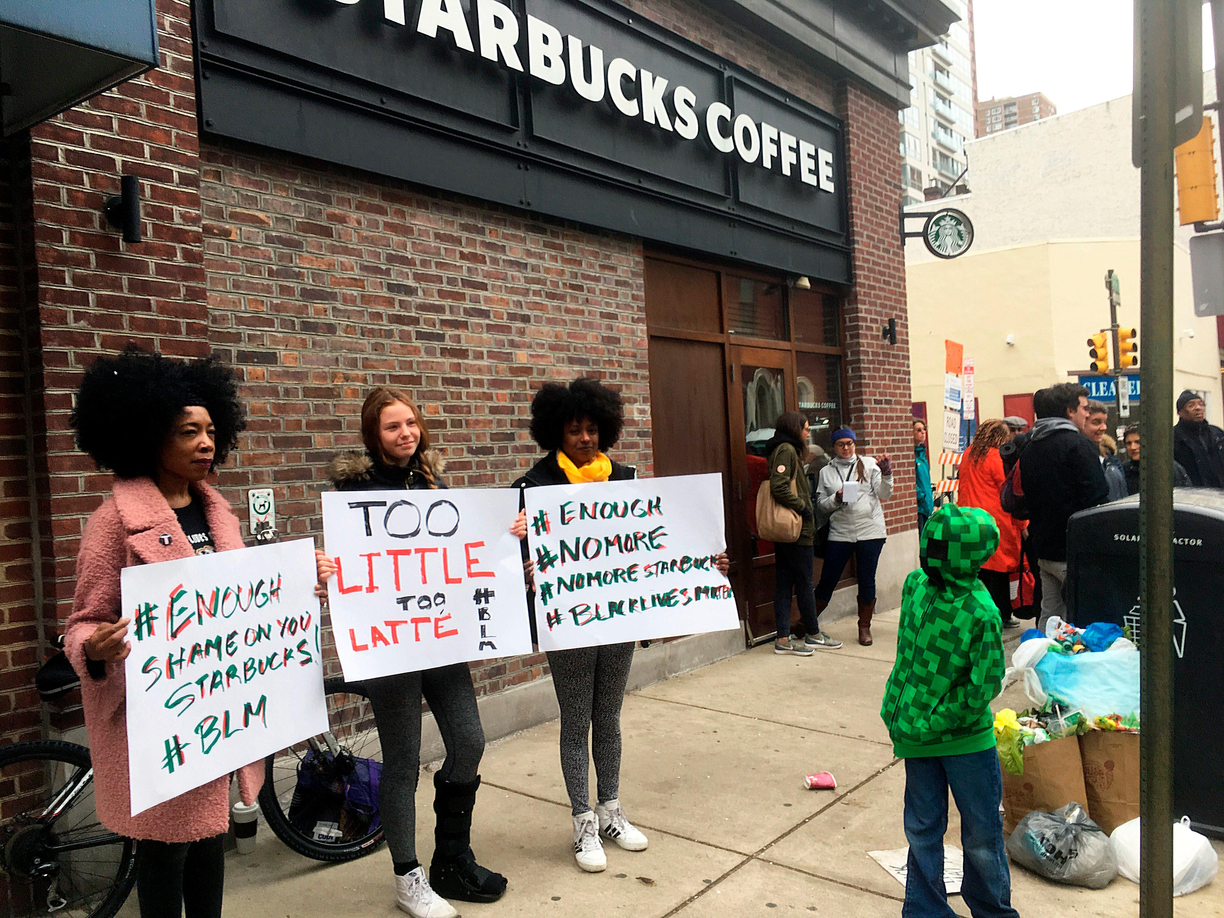 FILE – In this April 15, 2018, file photo, demonstrators protest outside the Starbucks cafe in Philadelphia where two black men were arrested three days earlier for waiting inside without ordering anything. On Tuesday, May 29, 2018, the company plans to close more than 8,000 stores nationwide to conduct anti-bias training, a move intended to show how serious the company is about living up to its now tarnished image as a neighborhood hangout where all are welcome. (AP Photo/Ron Todt, File)