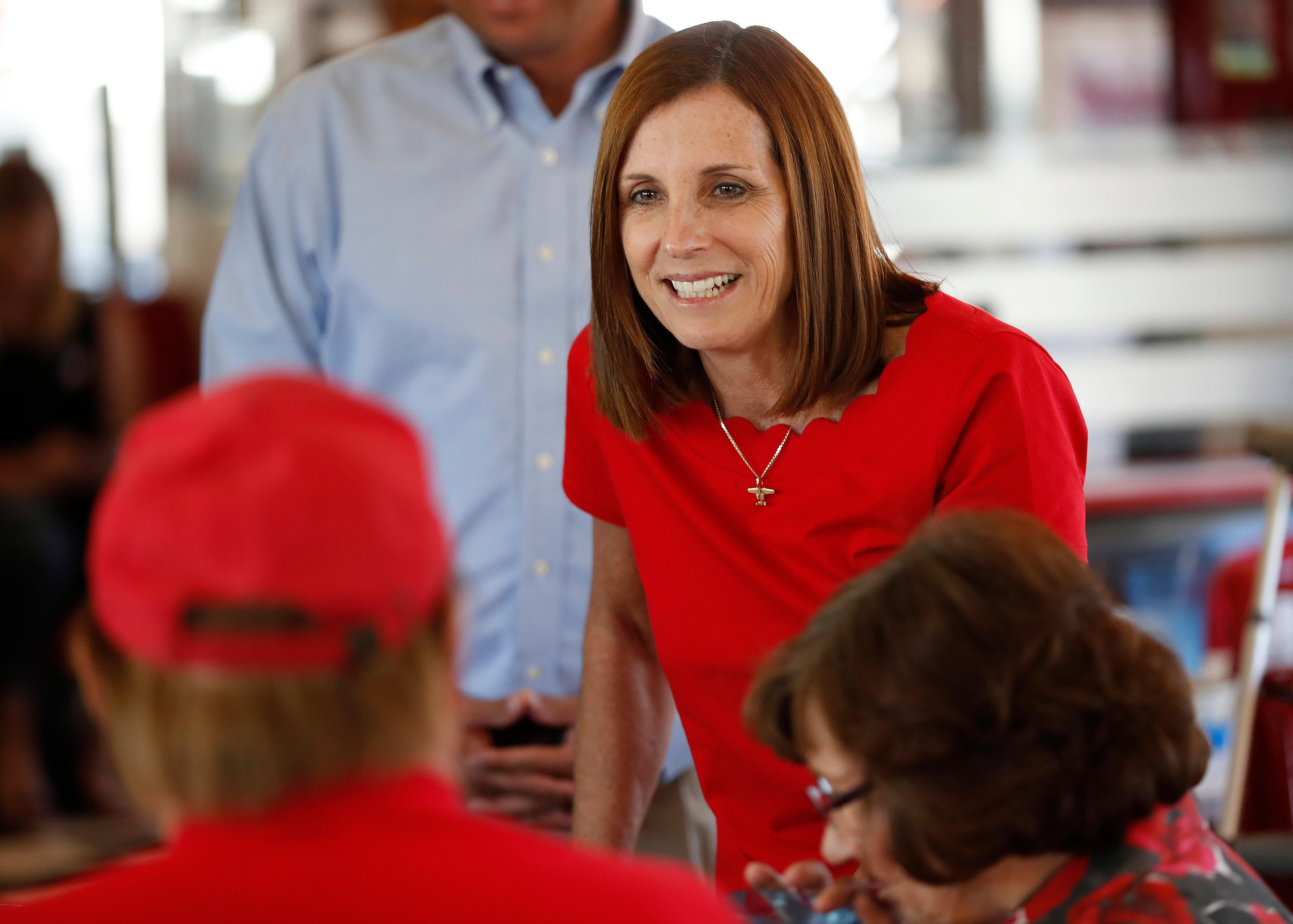 Arizona Republican senatorial candidate Martha McSally, speaks with voters, Tuesday, Nov. 6, 2018, at Chase's diner in Chandler, Ariz. (AP Photo/Matt York)