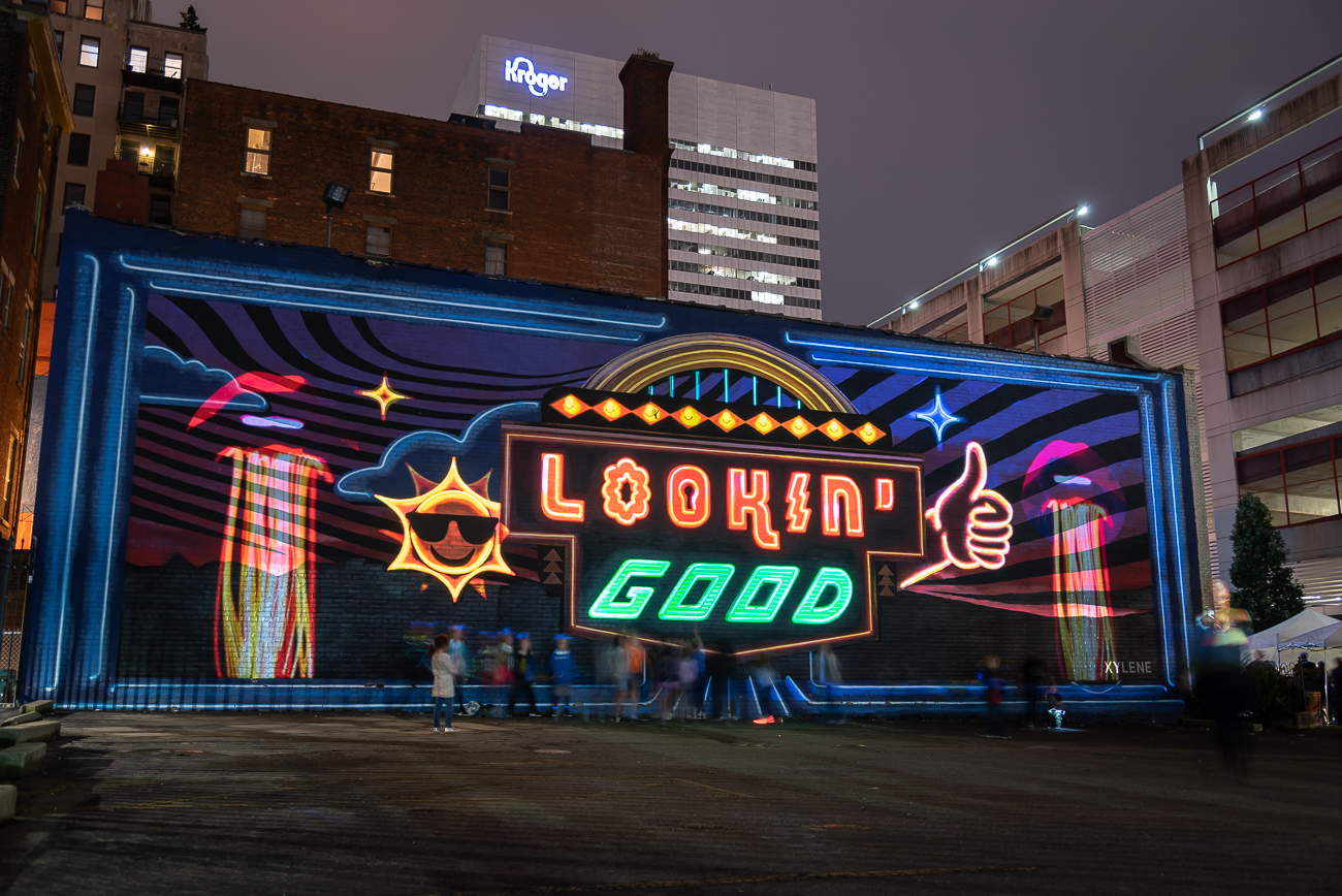 PICTURED NEIGHBORHOOD: Over-the-Rhine / The Lookin' Good mural on the side of Know Theatre is animated for BLINK. / Image: Phil Armstrong // Published: 10.12.19