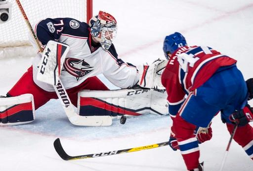 Columbus Blue Jackets goalie Sergei Bobrovsky makes a save off Montreal Canadiens' Alexander Radulov during the first period of an NHL hockey game, Tuesday, Feb. 28, 2017 in Montreal. (Paul Chiasson/The Canadian Press via AP)