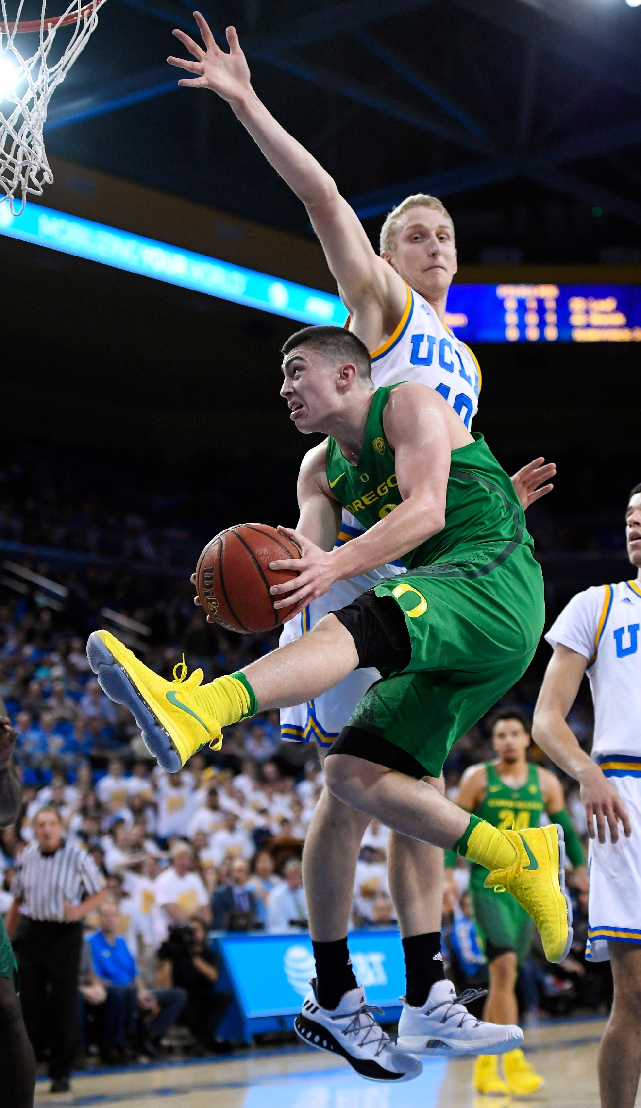 Oregon guard Payton Pritchard, below, shoots as UCLA center Thomas Welsh defends during the first half of an NCAA college basketball game, Thursday, Feb. 9, 2017, in Los Angeles. (AP Photo/Mark J. Terrill)
