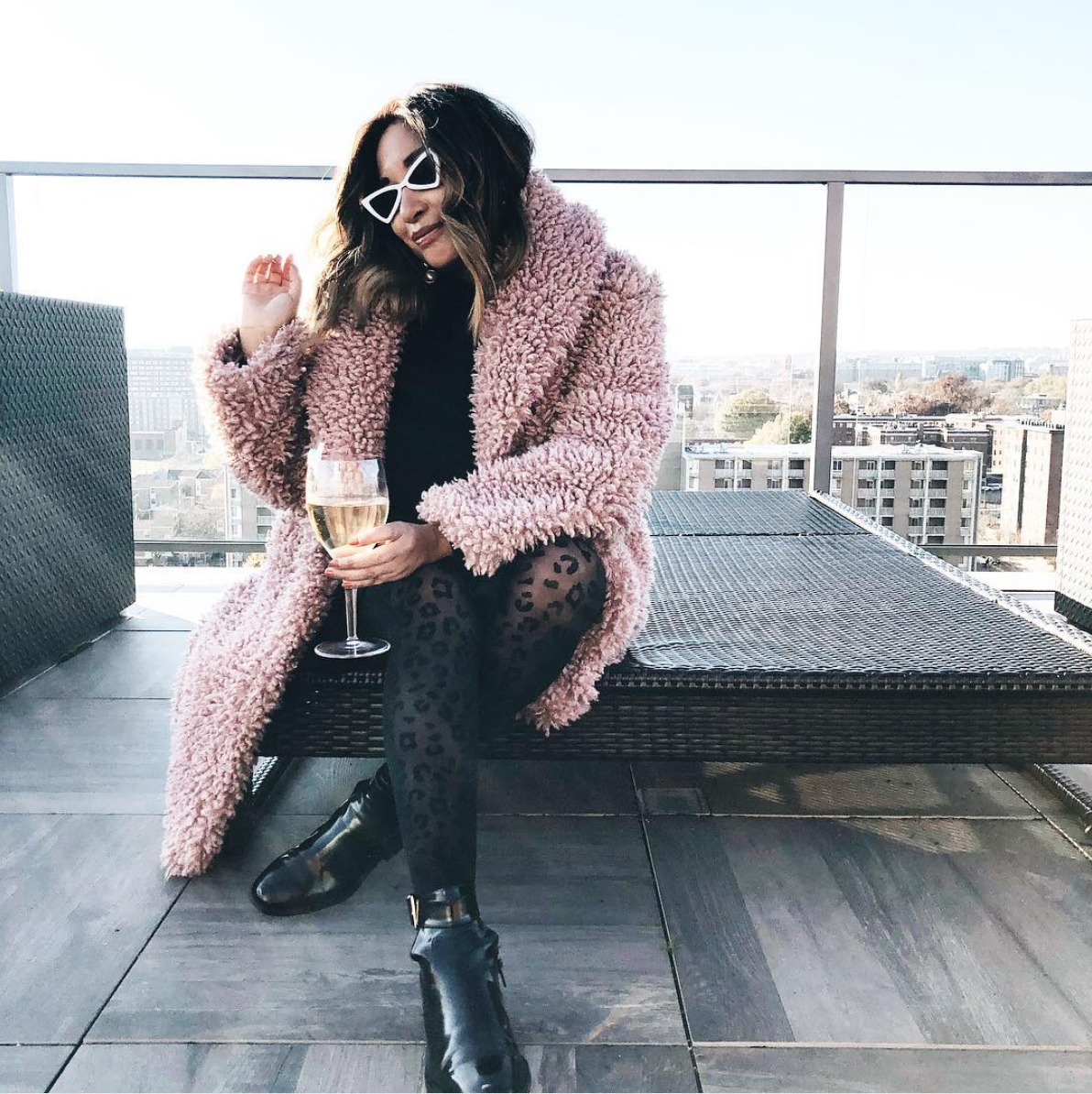 Boucle definitely doesn't blend in, but we love amping it up even more with some patterned tights and punchy accessories. (Image via @spicycandydc)