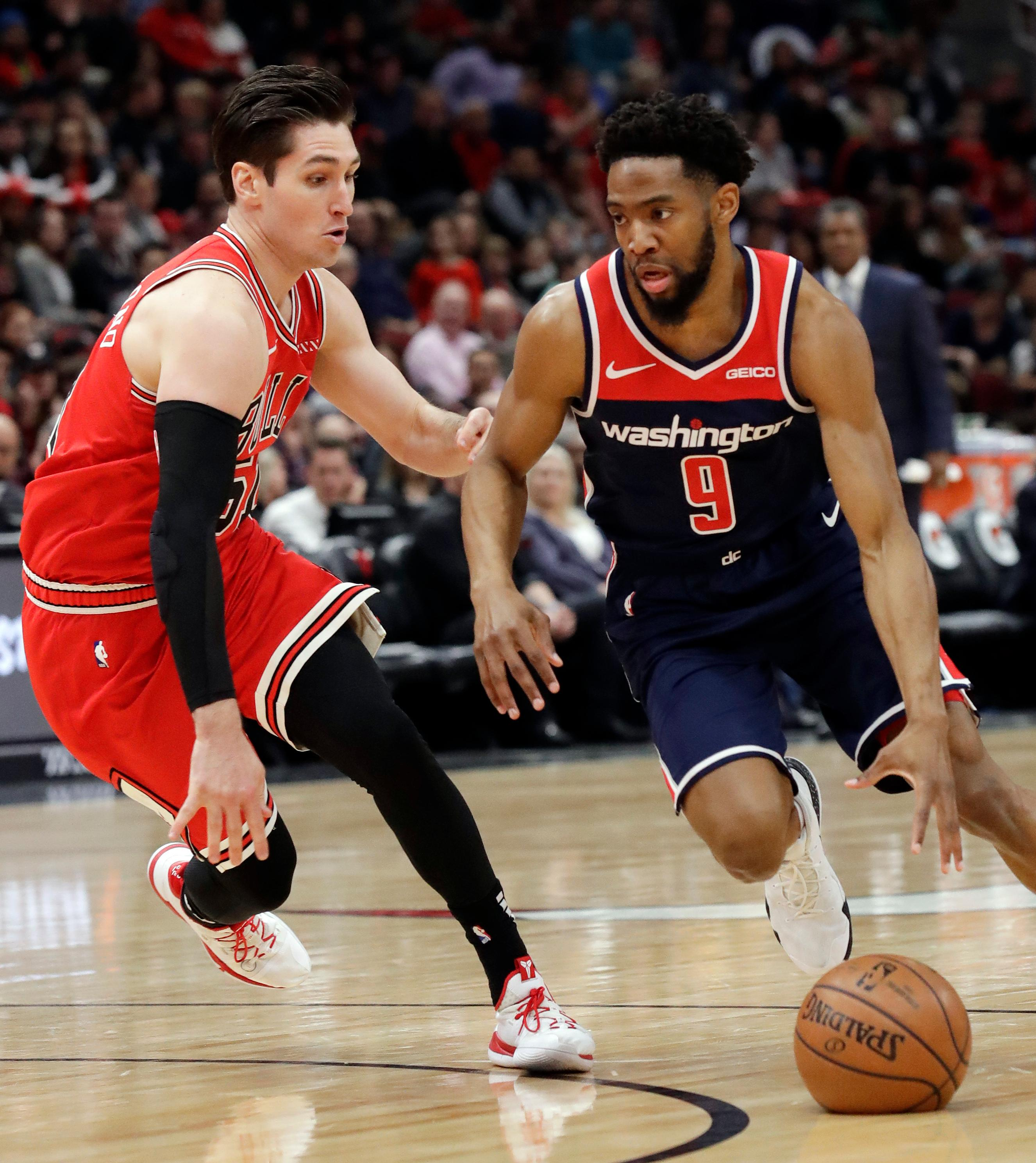 Washington Wizards guard Chasson Randle, right, drives against Chicago Bulls guard Ryan Arcidiacono during the first half of an NBA basketball game Wednesday, March 20, 2019, in Chicago. (AP Photo/Nam Y. Huh)