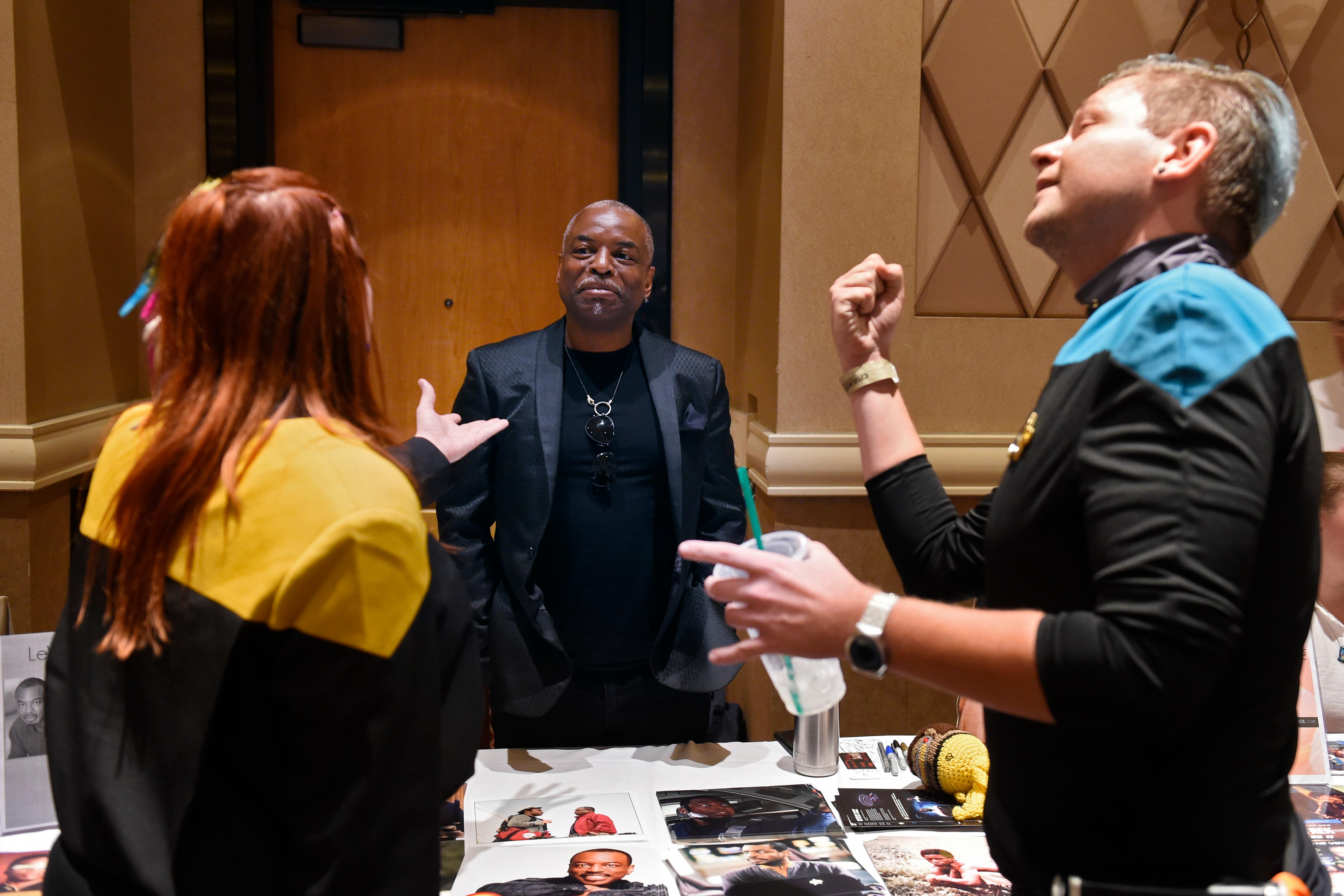 "Levar Burton, who portrayed Geordi La Forge in Star Trek: The Next Generation, is serenaded by Bonnie Gordon and Xander Jeanneret with a rendetion of the theme to Burton's show ""Reading Rainbow"" with new lyrics referring to his Star Trek Role during the 16th annual Las Vegas Star Trek Convention Saturday, August 5, 2017, at the Rio.  CREDIT: Sam Morris/Las Vegas News Bureau"