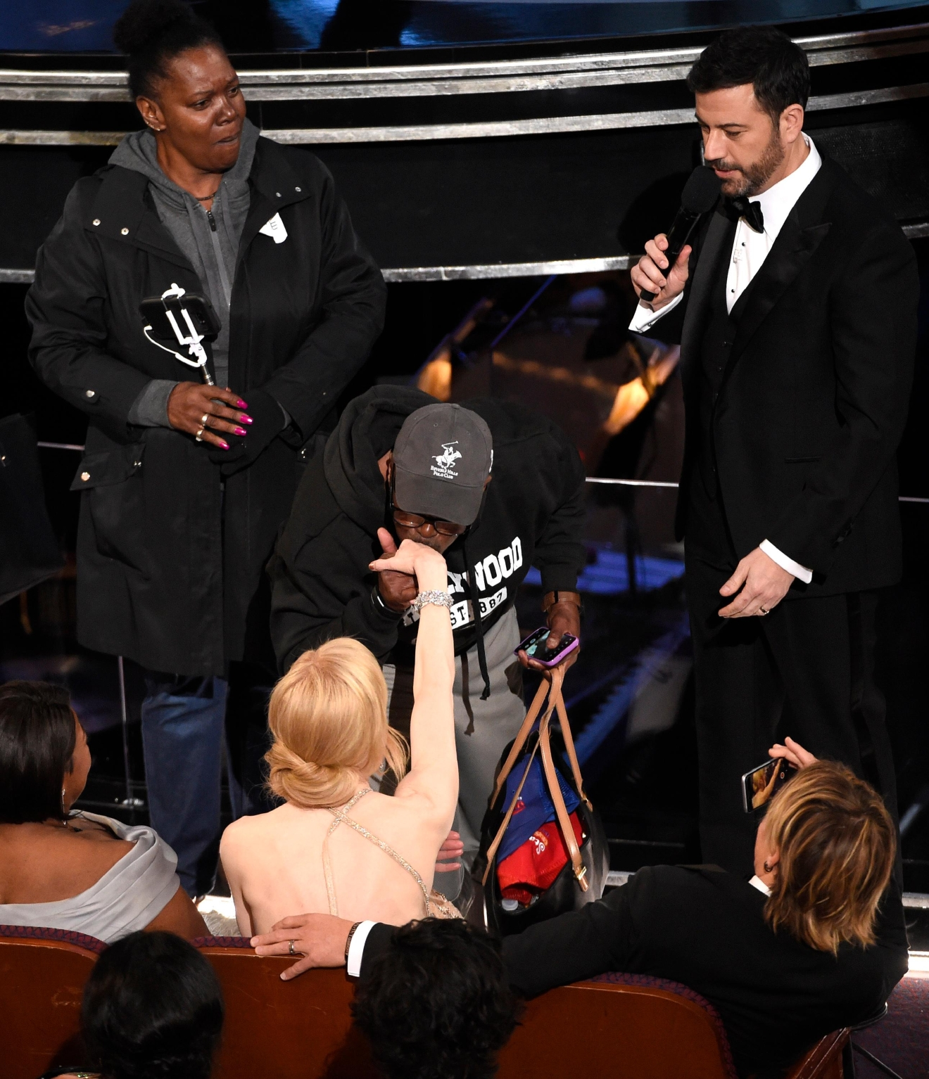 Jimmy Kimmel, from right, looks on as a tourist named Gary kisses Nicole Kidman's hand at the Oscars on Sunday, Feb. 26, 2017, at the Dolby Theatre in Los Angeles. (Photo by Chris Pizzello/Invision/AP)