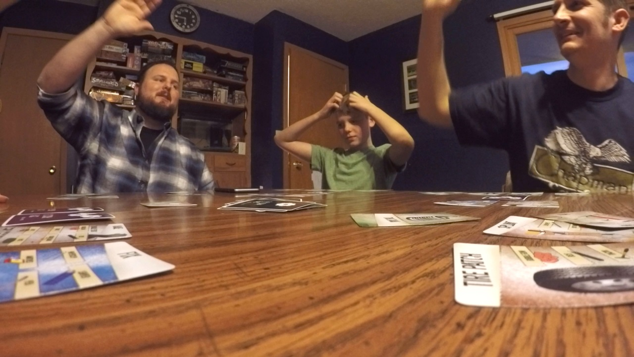 Jon Rhoades (left) high fives Scott Gamblin after beating the clock in the card game the friends created together (NTV News)