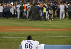 Los Angeles Dodgers right fielder Yasiel Puig watches as the Houston Astros celebrate their win in Game 7 of the World Series Wednesday, Nov. 1, 2017, in Los Angeles. The Astros won 5-1 to win the series 4-3.
