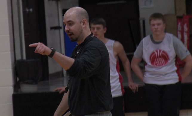 Broken Bow head coach Nate Olson (left) points out proper position during a March 2, 2018 practice (KHGI)<p></p>