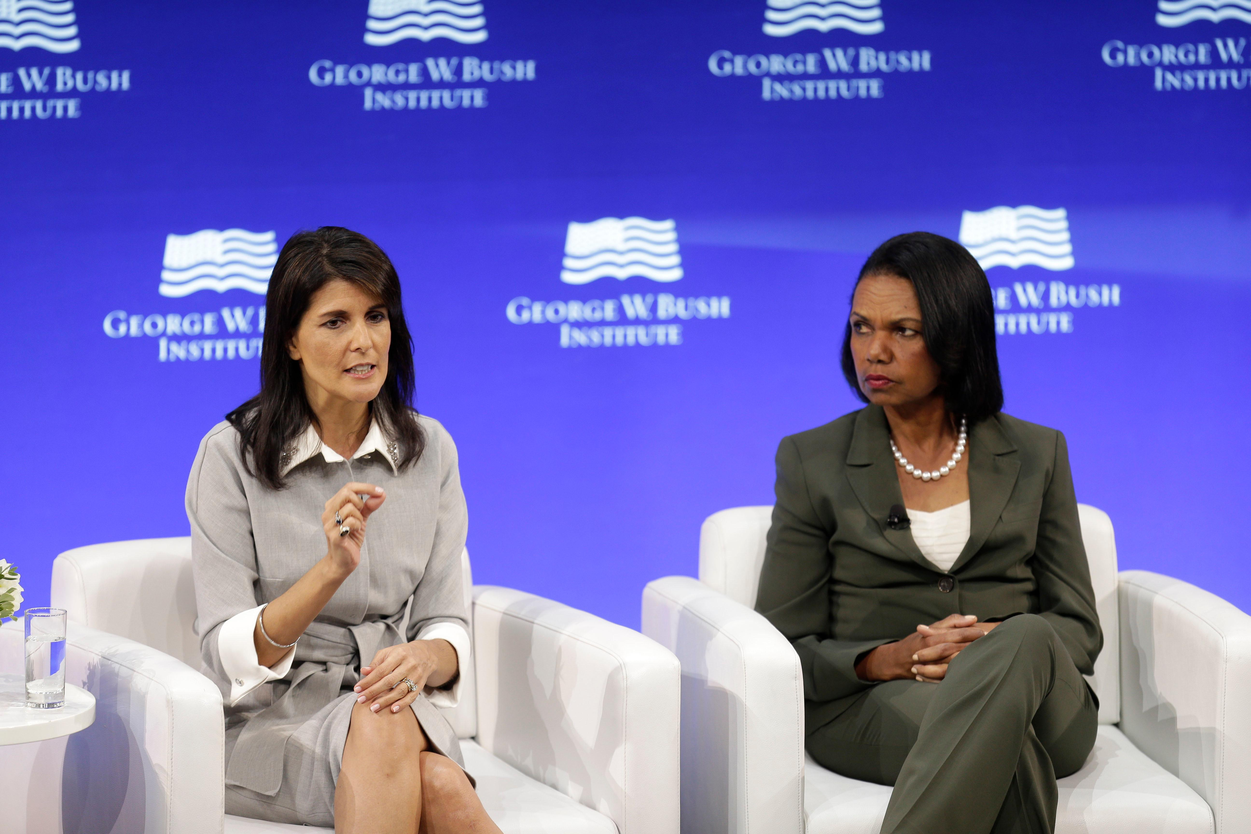 U.S. Ambassador to the United Nations Nikki Haley, left, and former U.S. Secretary of State Condoleezza Rice participate in a panel discussion at a forum sponsored by the George W. Bush Institute in New York, Thursday, Oct. 19, 2017. (AP Photo/Seth Wenig)