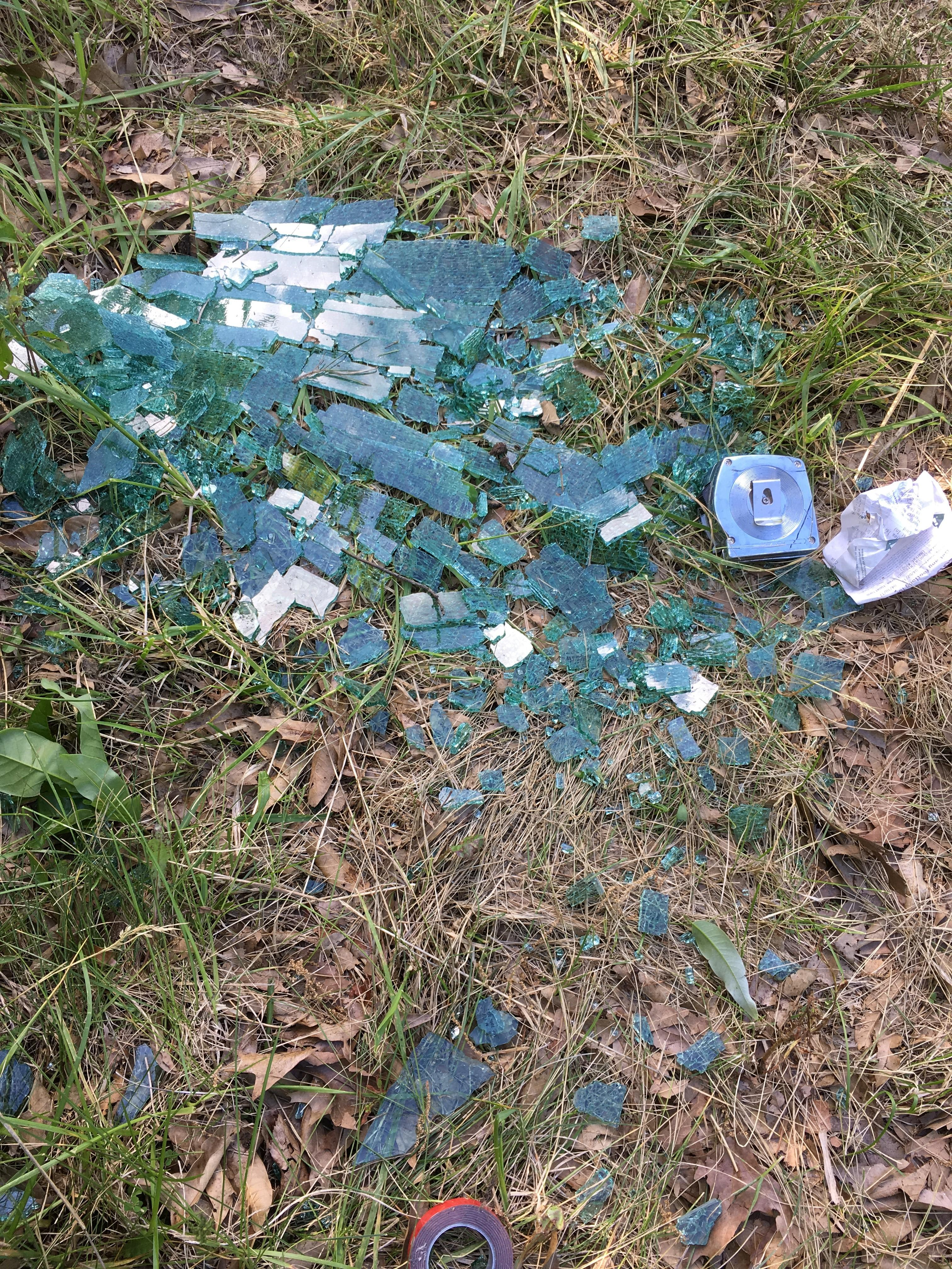 Broken glass from the wrecked SUV's window was scattered in the grass along the road where the crash happened. (John Garlock/KTVO)
