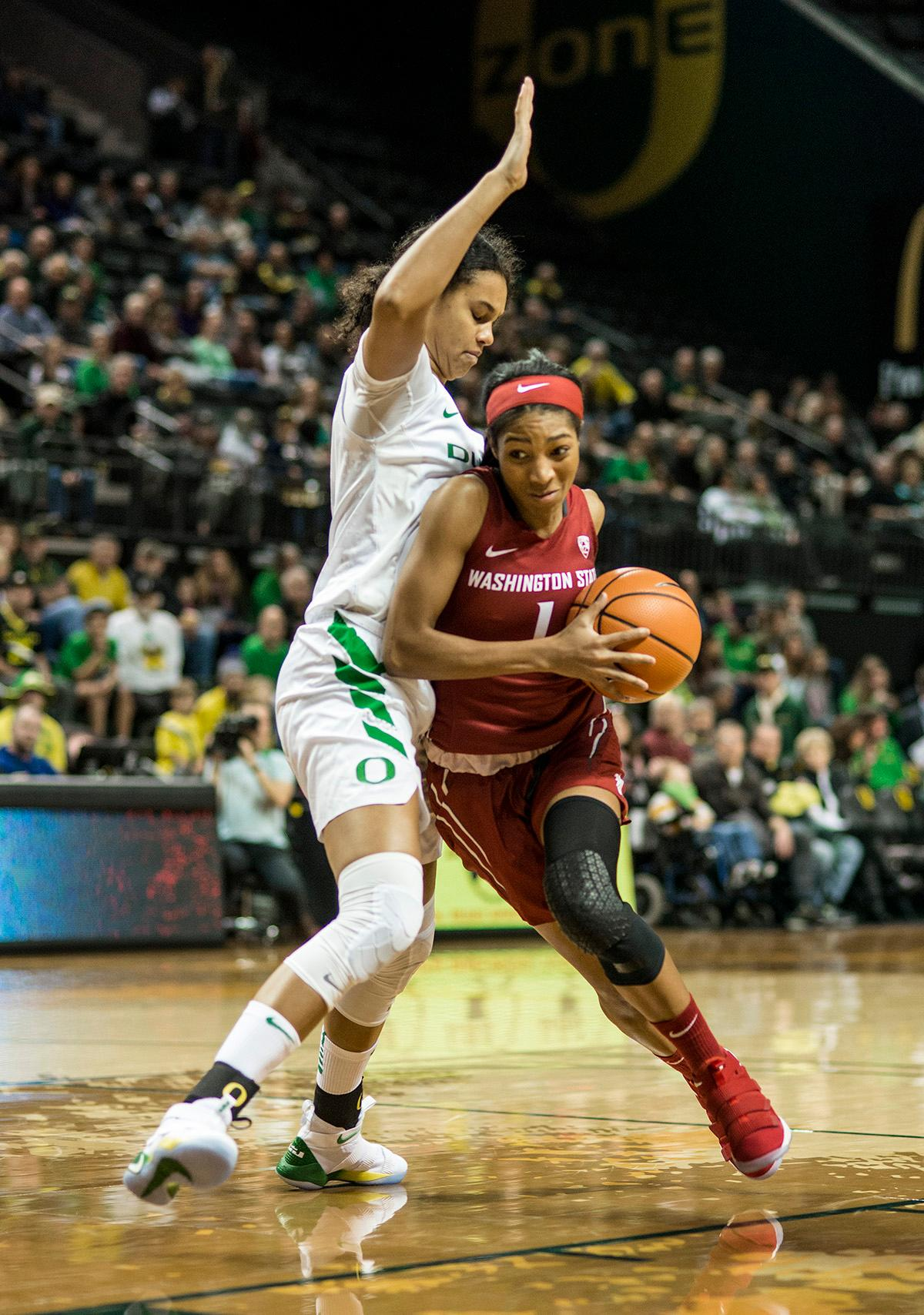 Washington State University Cougars Caila Kailey (#1) attempts to drive past the Oregon defense. In their first conference basketball game of the season, the Oregon Women Ducks defeated the Washington State Cougars 89-56 in Matt Knight Arena Saturday afternoon. Oregon's Ruthy Hebard ran up 25 points with 10 rebounds. Sabrina Ionescu shot 25 points with five three-pointers and three rebounds. Lexi Bando added 18 points, with four three-pointers and pulled down three rebounds. Satou Sabally ended the game with 14 points with one three-pointer and two rebounds. The Ducks are now 12-2 overall with 1-0 in conference and the Cougars stand at 7-6 overall and 0-1 in conference play. The Oregon Women Ducks next play the University of Washington Huskies at 1:00 pm on Sunday. Photo by Rhianna Gelhart, Oregon News Lab