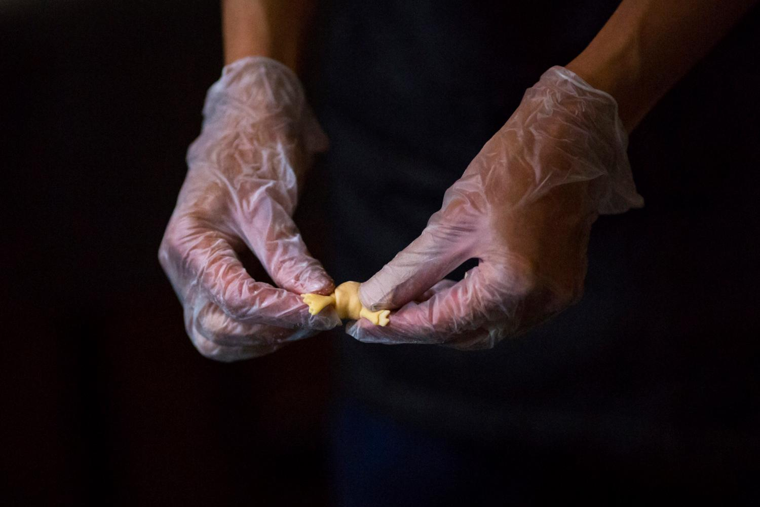 Hand making the cappalletti for our main course (Image: Sy Bean / Seattle Refined).