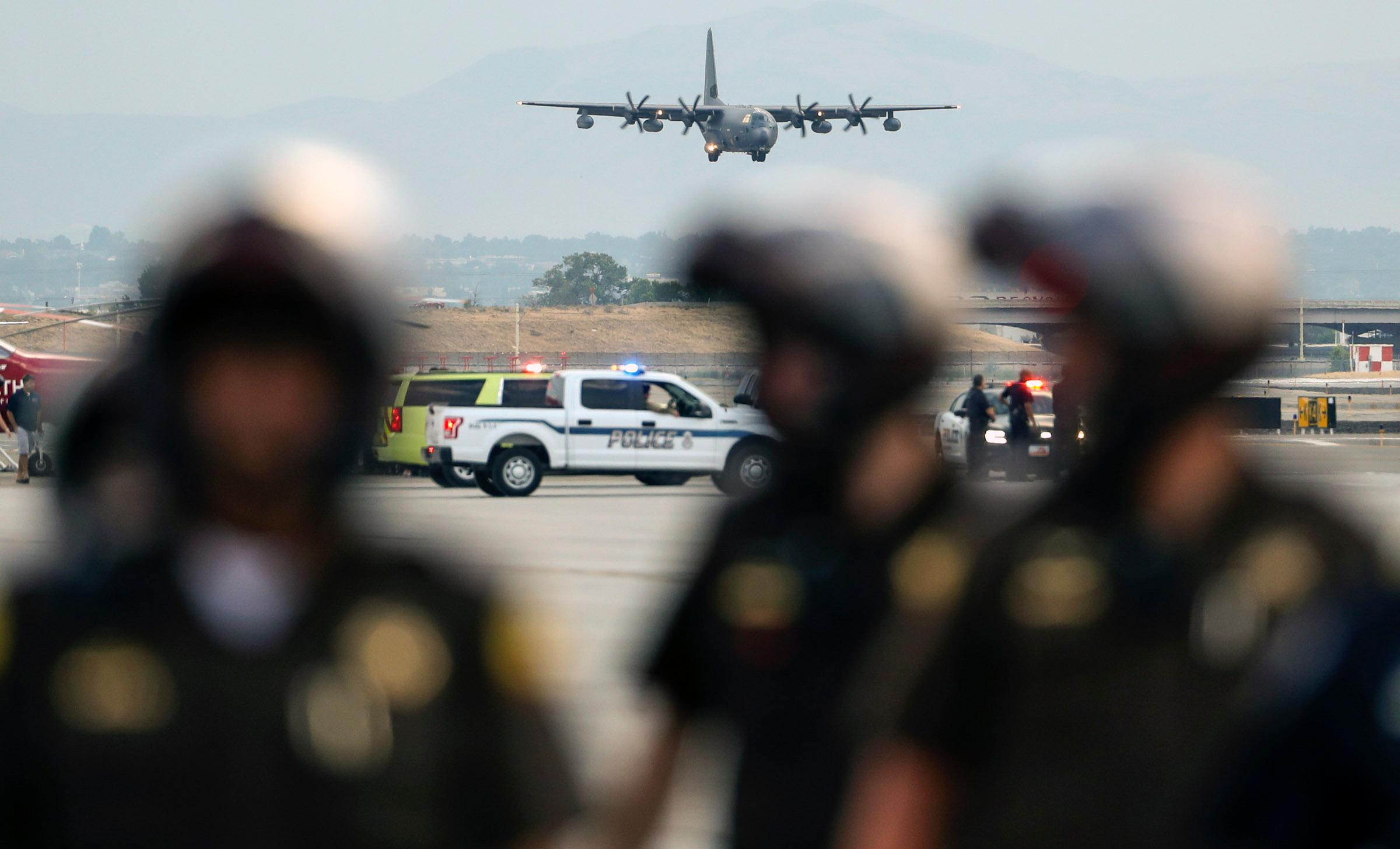 A  C130-J carrying the  casket of Draper Battalion Chief Matt Burchett prepares to landa at the Utah Air National Guard Base in Salt Lake City on Wednesday, Aug. 15, 2018. Burchett was killed while fighting the Mendocino Complex Fire north of San Francisco.