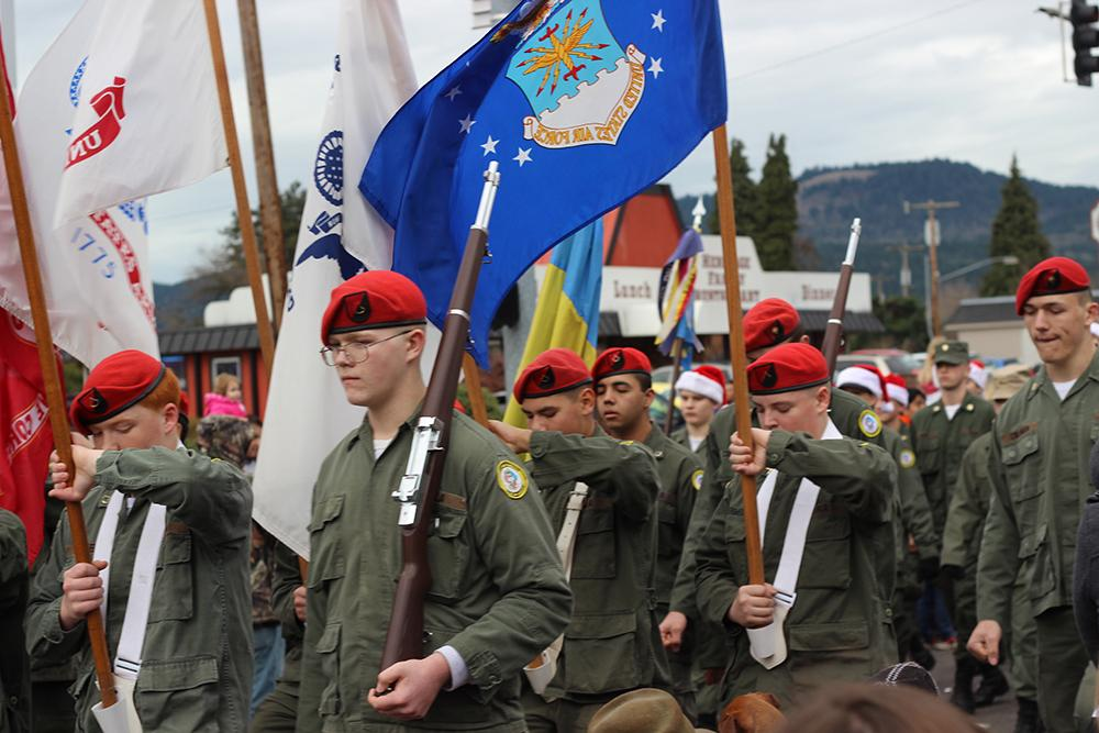 High school ROTC members marched at the 63rd Annual Springfield Christmas Parade in Springfield, Ore., Saturday, Dec. 5. Photo by Claire Aubin.
