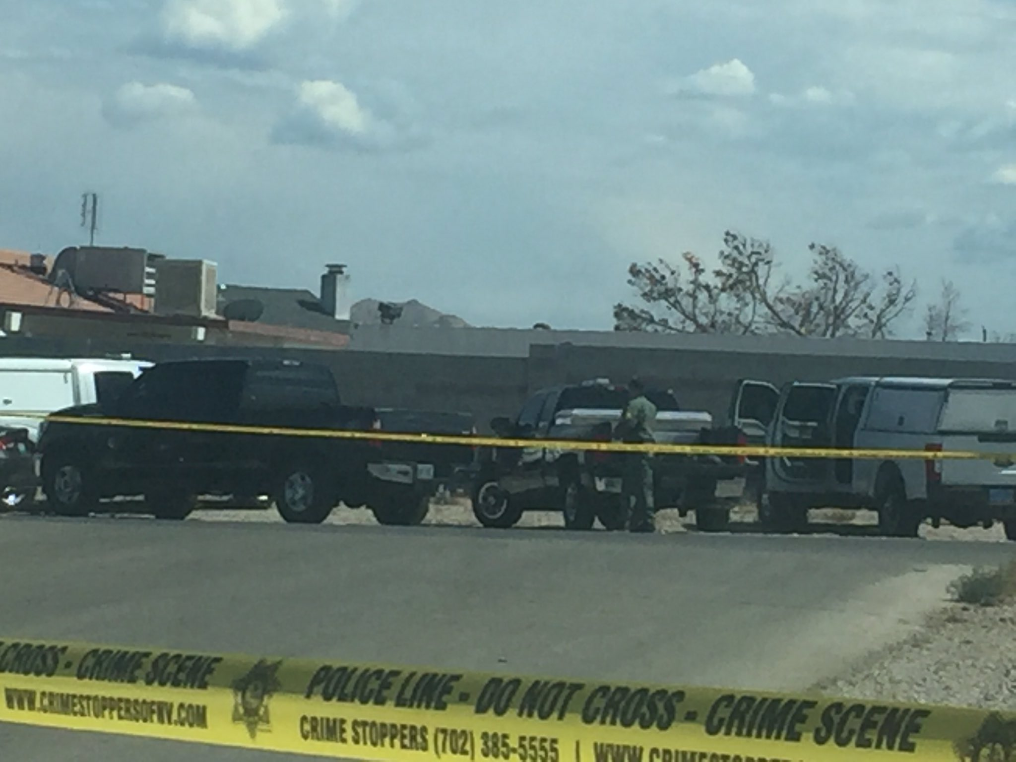 LVMPD officers say a man was barricaded in an abandoned home near Rainbow and Blue Diamond (Antonio Castelan | KSNV)