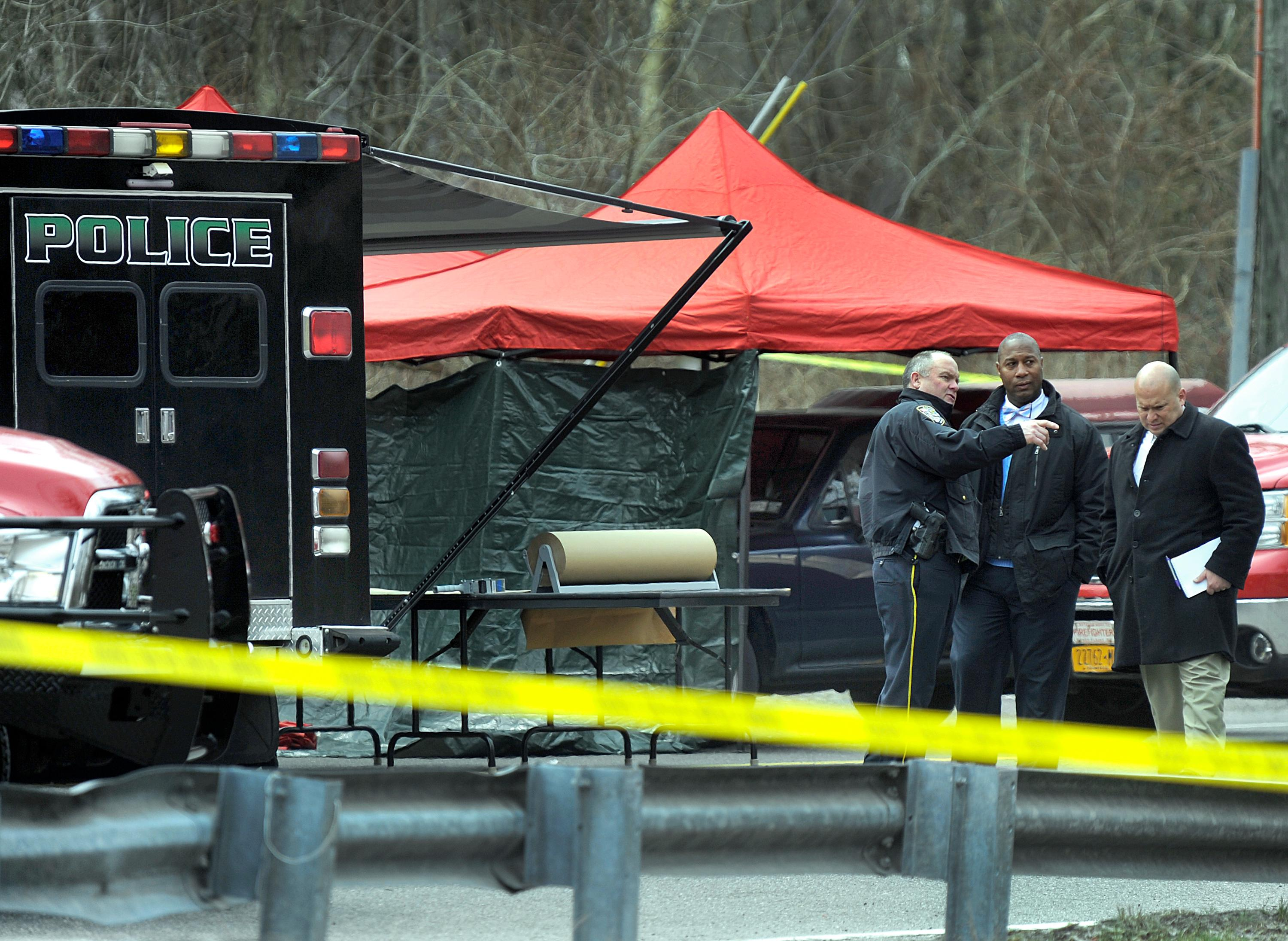 Police work at the scene where a man and a woman were found slain in a pickup truck near the intersection of Routes 55 and 7, Thursday morning, April 12, 2018, in Gaylordsville, Conn. Authorities said the suspect was found dead of a self-inflicted gunshot across the state line in New York. (Carol Kaliff/Hearst Connecticut Media via AP)
