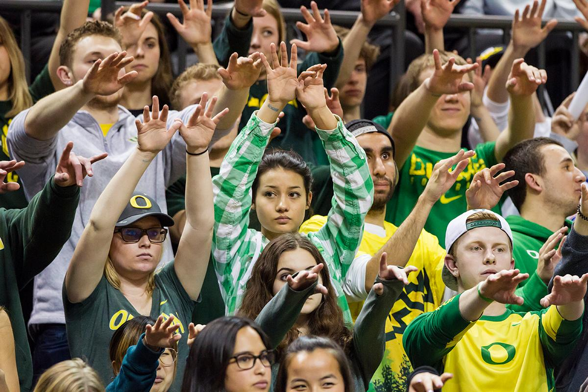The Pit Crew wave silently to cheer on an Oregon free-throw. The Oregon Ducks defeated the Arizona State Sun Devils 71 to 70. Photo by Ben Lonergan, Oregon News Lab