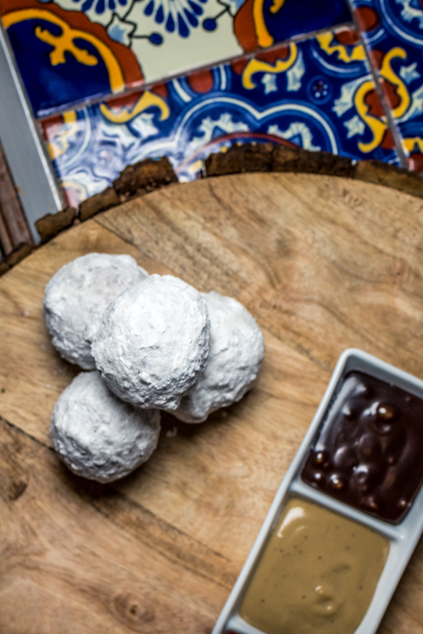 Ricotta Donuts coated in powdered sugar with a trio of dipping sauces / Image: Catherine Viox{ }// Published: 4.21.20