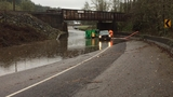 'Both lanes of the road are flooded and water is continuing to rise'
