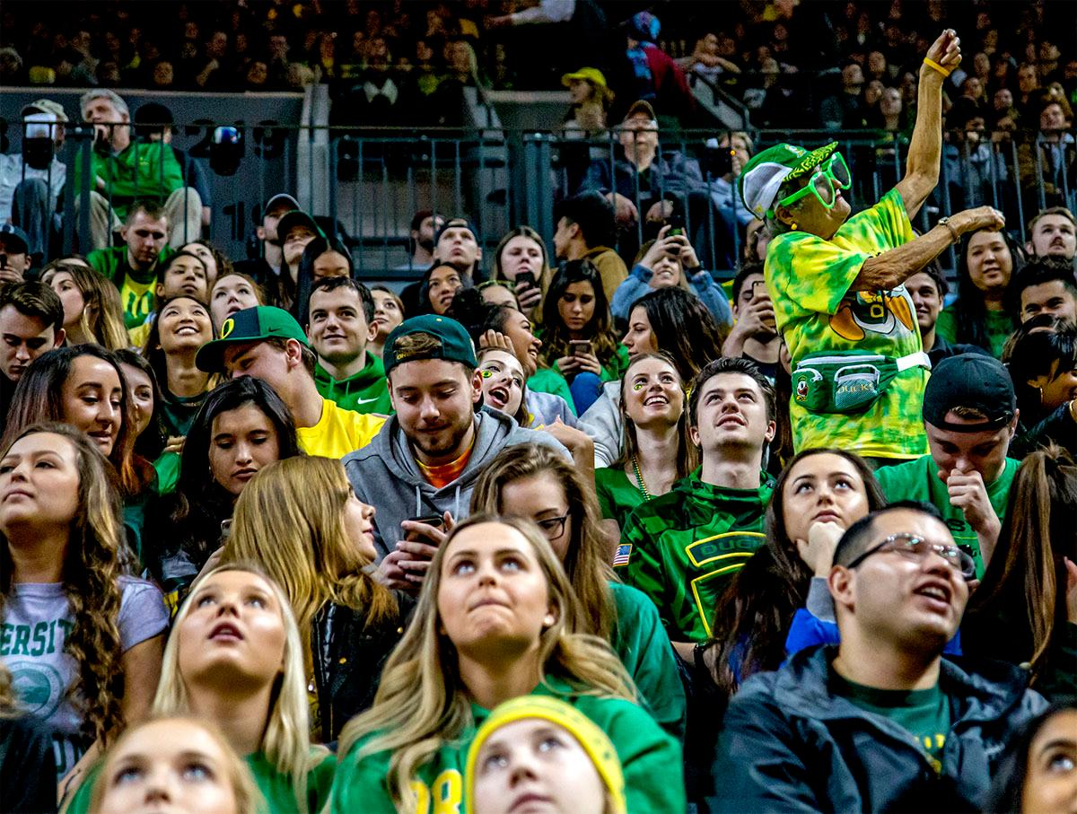Fans await the start of the game. The Ducks defeated the Beavers in the civil war game, 66-57, at Matthew Knight Arena on Saturday night. Elijah Brown scored a game high of 20 points with 18 of the points coming in the first half, Paul White added 17 points. The Ducks are now 14-7 overall and 4-4 in conference play. The Ducks will next face California on Thursday Feb. 1 at 6:00 p.m. Photo by August Frank, Oregon News Lab