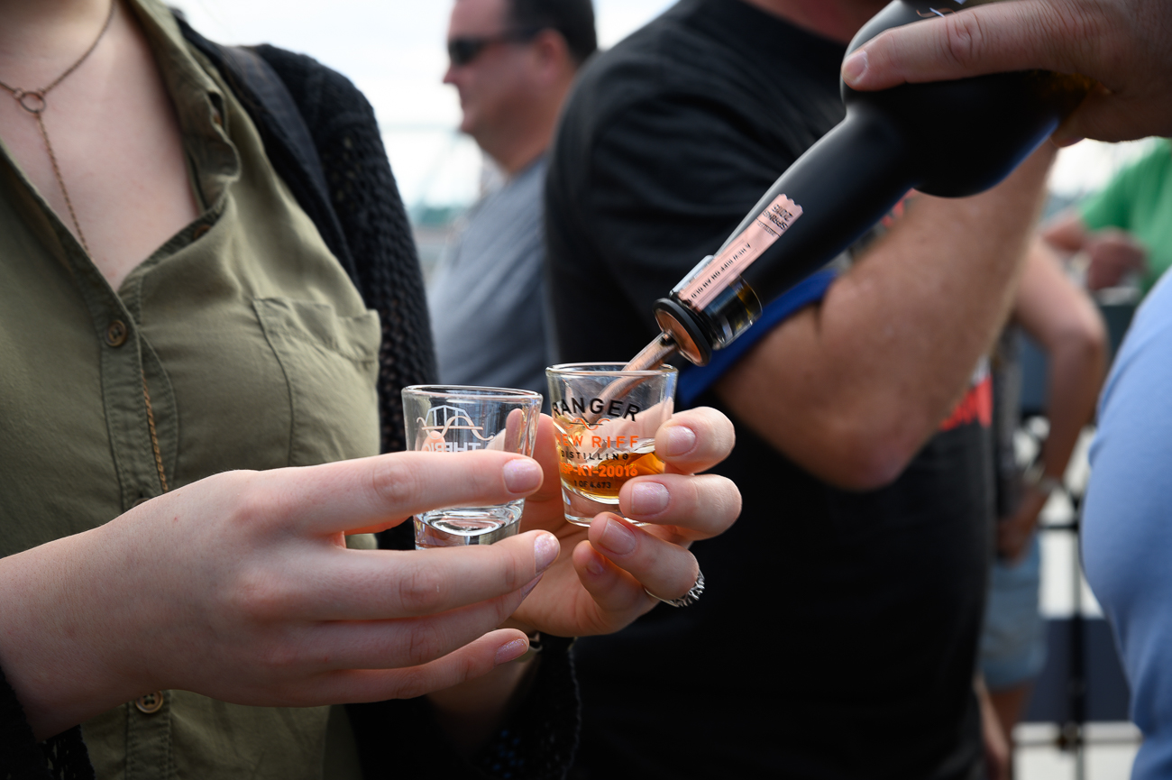This bourbon-lover made brilliant use of both hands by filling each of them with a glass. / Image: Phil Armstrong // Published: 6.14.19