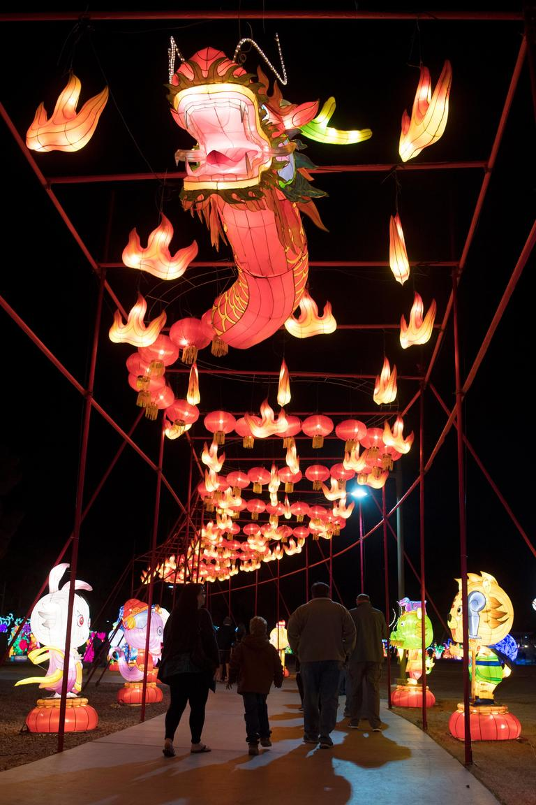 People walk under a flaming dragon on the opening night of the China Lights lantern festival Friday, January 19, 2018, at Craig Ranch Regional Park in North Las Vegas. The festival, which features nearly 50 silk and LED light displays comprised of over 1000 elements, runs through February 25th. CREDIT: Sam Morris/Las Vegas News Bureau