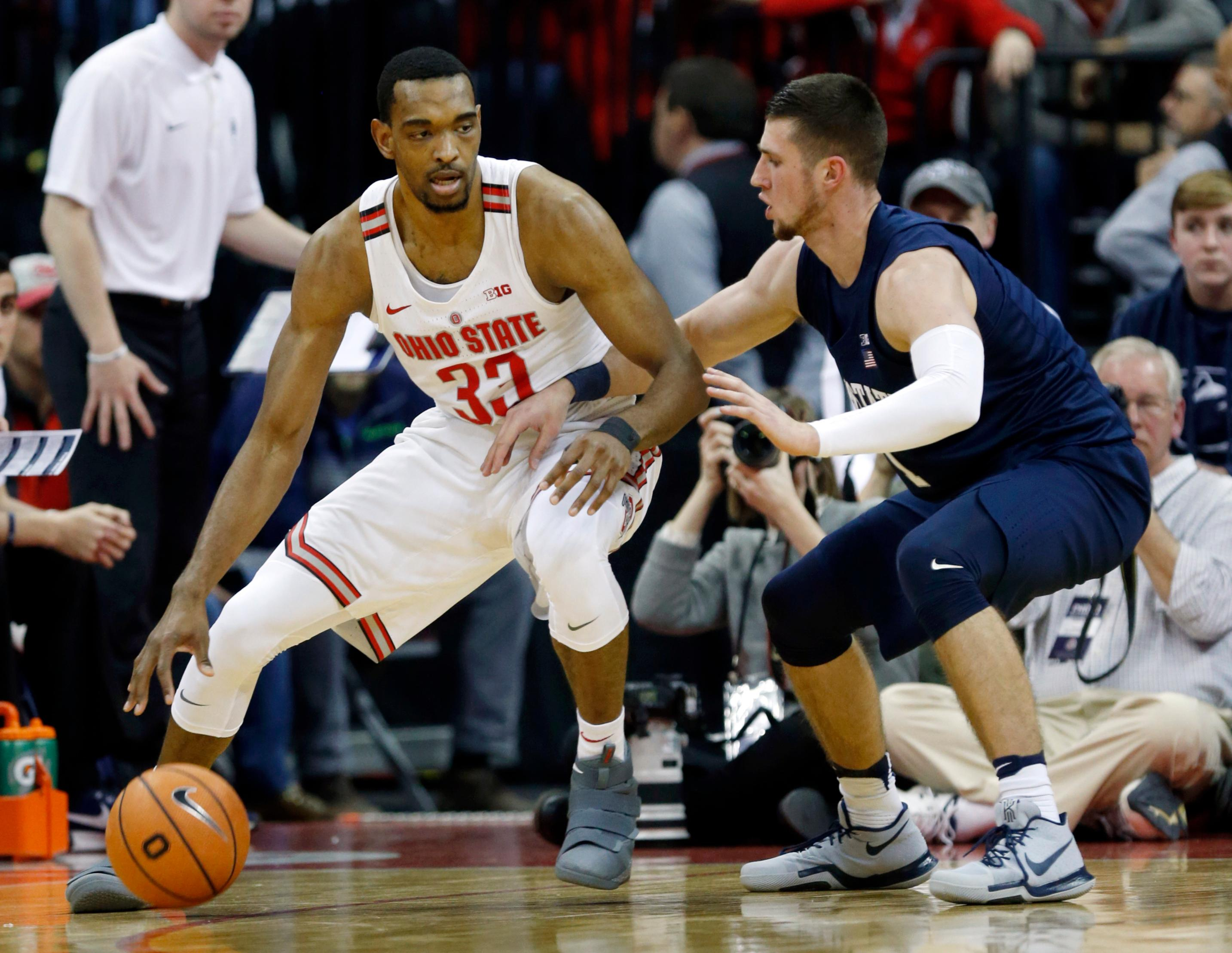 FILE - In this Jan. 25, 2018, file photo, Ohio State forward Keita Bates-Diop, left, drives against Penn State forward Deivis Zemgulis during an NCAA college basketball game in Columbus, Ohio. Chris Holtmann's first season coaching at Ohio State was a hit after the Buckeyes exceeded preseason expectations to finish 15-3 in the league to get the second seed in the Big Ten conference tournament. Bates-Diop, who averages 19.2 points and 8.9 rebounds per game, won league player of the year honors. (AP Photo/Paul Vernon, File)