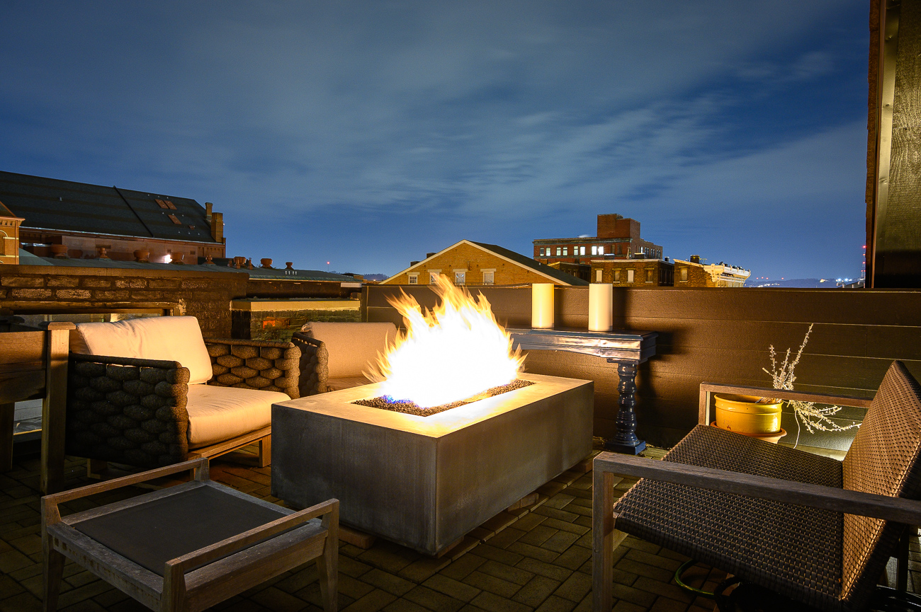 A rooftop fire pit will keep renters warm on cold nights. / Image: Phil Armstrong // Published: 12.6.19