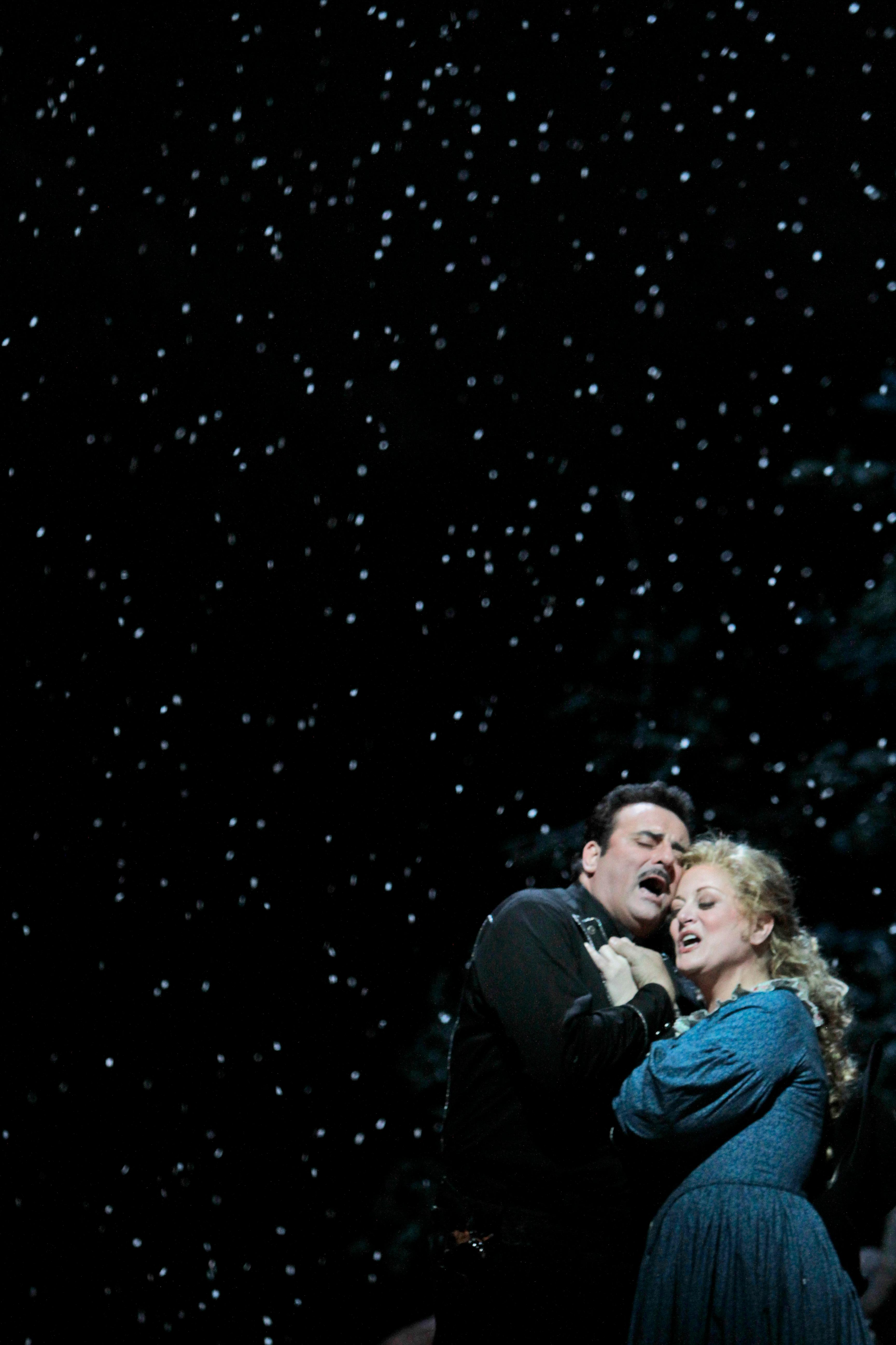 "FILE - This Friday, Dec. 3, 2010, file photo shows Marcello Giordani, left, performing as Ramerrez alongside Deborah Voigt performing as Minnie during the final dress rehearsal of Giacomo Puccini's ""La Fanciulla del West,"" at the Metropolitan Opera in New York. Tenor Marcello Giordani, renowned for a voice of beauty and heft that made him a star at the world's top opera houses, died Saturday, Oct. 5, 2019. He was 56. (AP Photo/Mary Altaffer, File)"