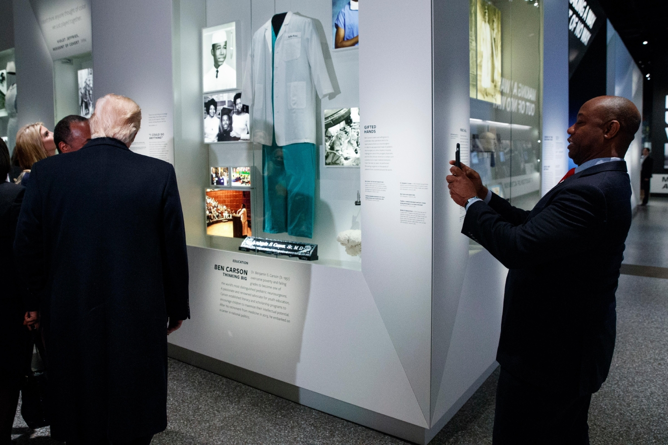 Sen. Tim Scott, R-S.C., takes a photo of President Donald Trump during a tour of the National Museum of African American History and Culture, Tuesday, Feb. 21, 2017, in Washington. (AP Photo/Evan Vucci)