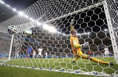 England's goalkeeper Joe Hart fails to stop a goal by Italy's Mario Balotelli's during the second half of the group D World Cup soccer match between England and Italy at the Arena da Amazonia in Manaus, Brazil, Saturday, June 14, 2014.