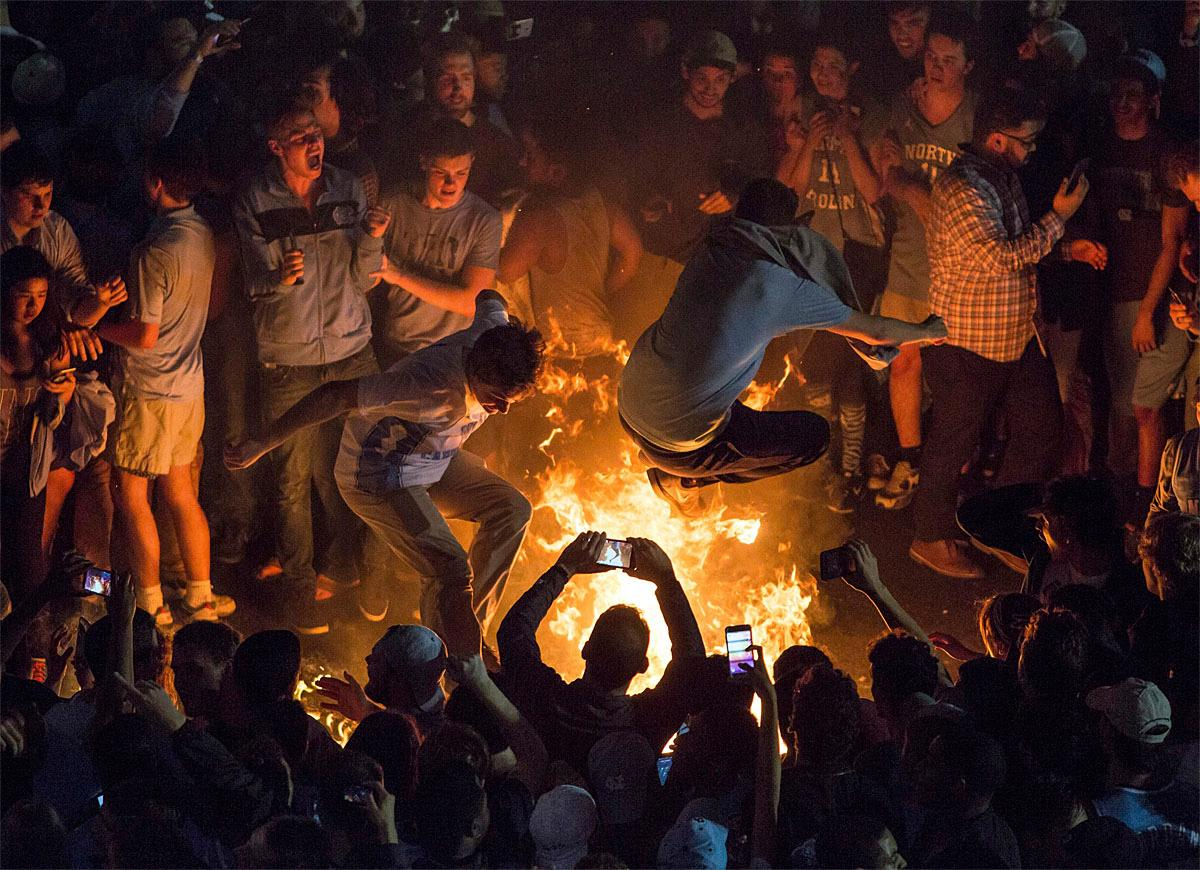 North Carolina fans celebrate on Franklin Street following its victory over Gonzaga in the NCAA college basketball championship in Chapel Hill, N.C., Monday, April 3, 2017. (AP Photo/Ben McKeown)