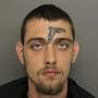Man with gun tattooed on forehead arrested unlawful carrying of a firearm