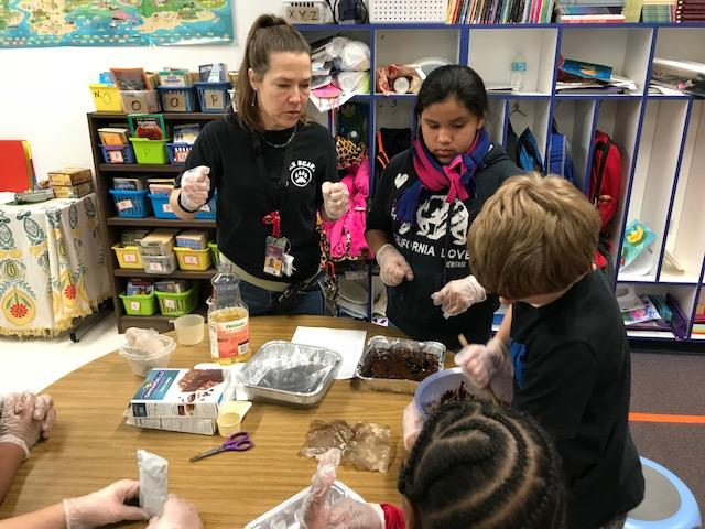 Students in Terrie Downing's fourth-grade classroom prepared a meal for local firefighters. The lunch included baked spaghetti and a big salad. (Photo credit: WLOS staff)