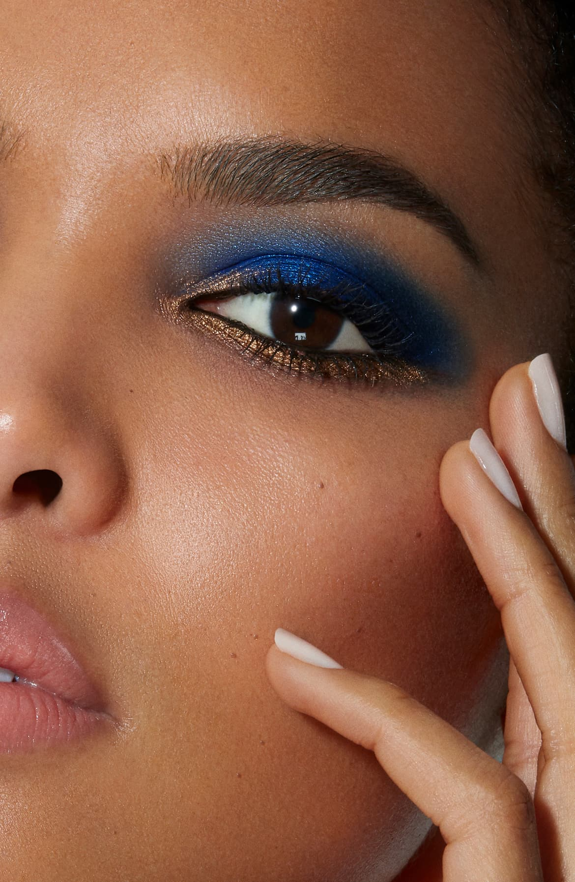Oh heyyyy!{ }{ }The eye makeup of the '80s was bold, bright and blue. To try and master the makeup trend, wear some blue shadow or liner. Don't go overboard, less is more here. (Image: Nordstrom){ }