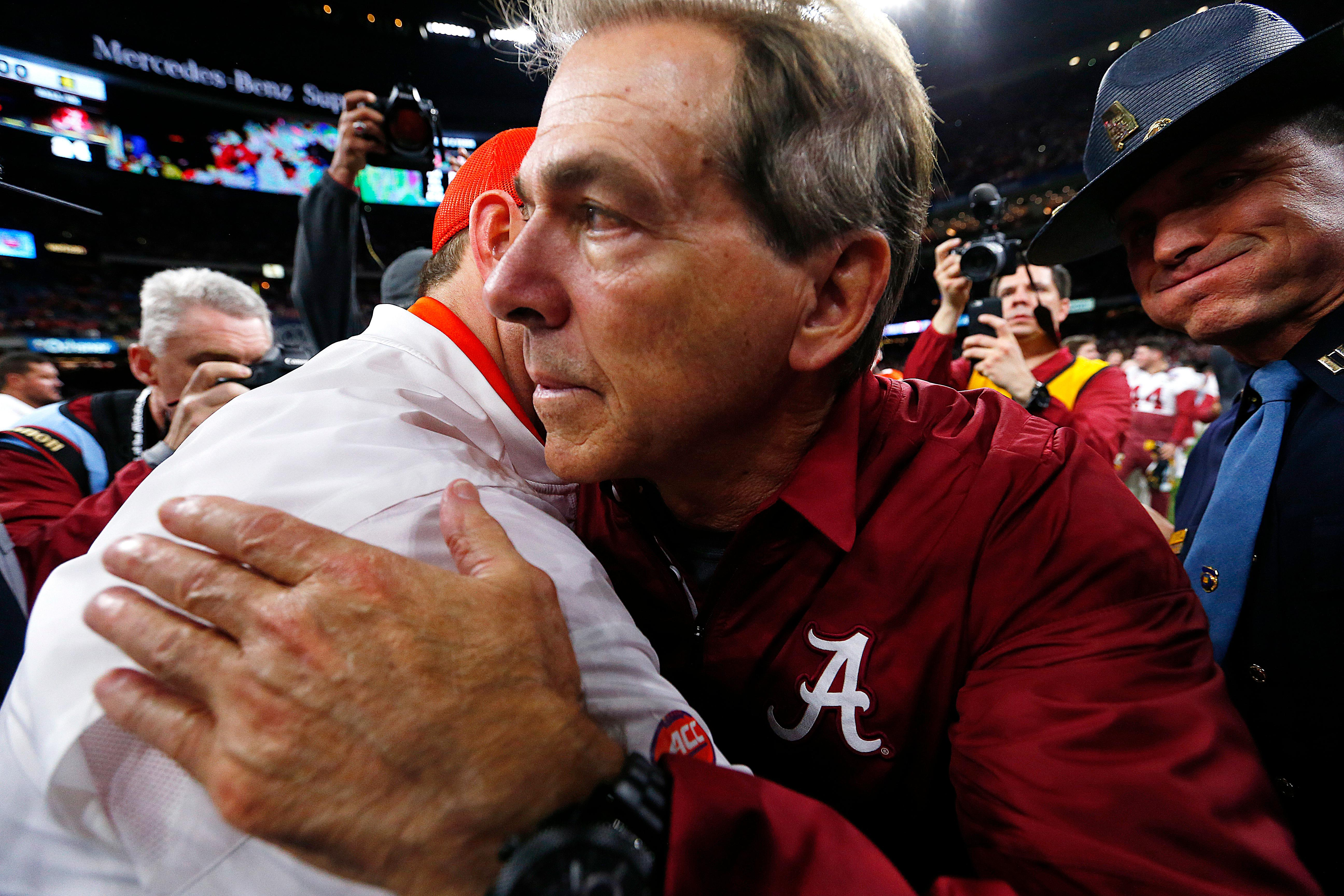 Alabama head coach Nick Saban, right, hugs Clemson head coach Dabo Swinney after the Sugar Bowl semi-final playoff game for the NCAA college football national championship, in New Orleans, Monday, Jan. 1, 2018. Alabama won 24-6 to advance to the national championship game. (AP Photo/Butch Dill)