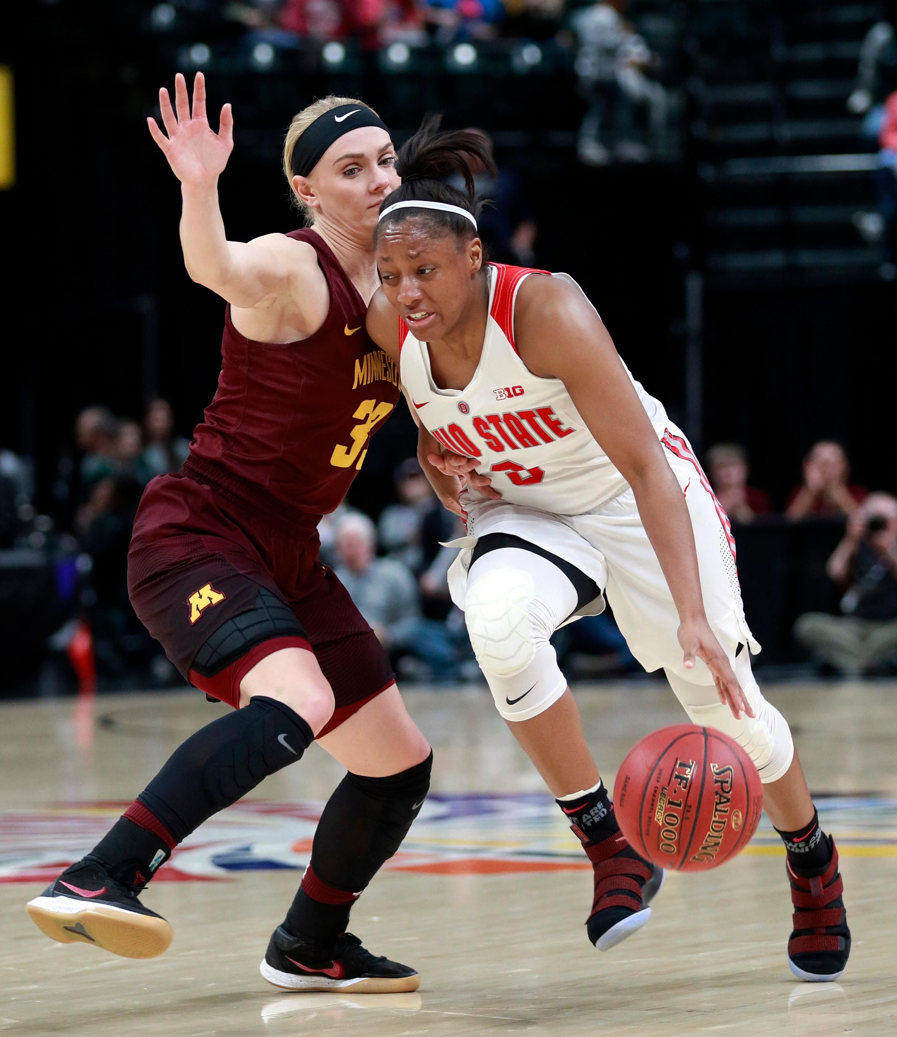 Ohio State guard Kelsey Mitchell, right, drives around Minnesota guard Carlie Wagner during the second half of an NCAA college basketball game in the semifinals of the Big Ten women's tournament, Saturday, March 3, 2018, in Indianapolis. Ohio State won 90-88. (AP Photo/R Brent Smith)