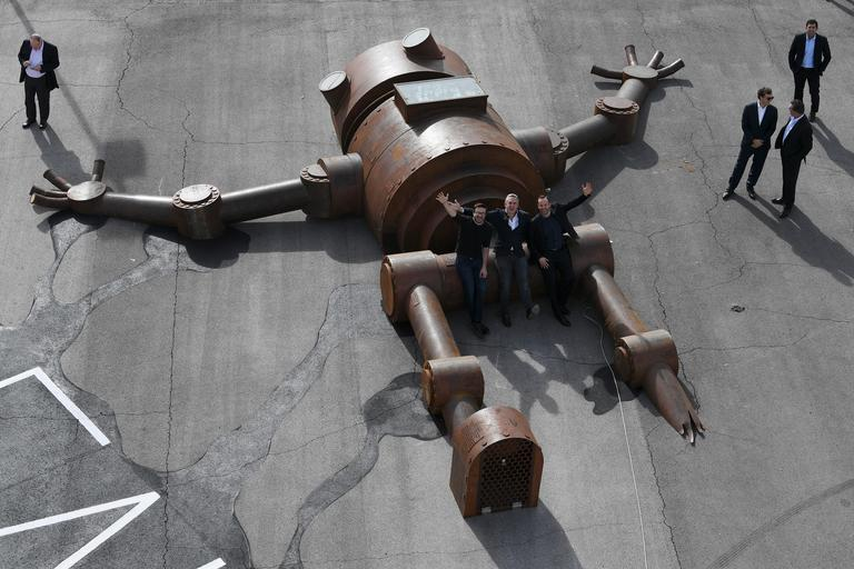 From left, Meow Wolf art collective CEO Vince Kadlubek, developer Winston Fisher and designer Michal Beneville pose next to the Mechan 9 robot sculpture during an event announcing the establishment of Area 15, a curated retail, dining and immersive entertainment venue, Thursday, January 18, 2018. CREDIT: Sam Morris/Las Vegas News Bureau
